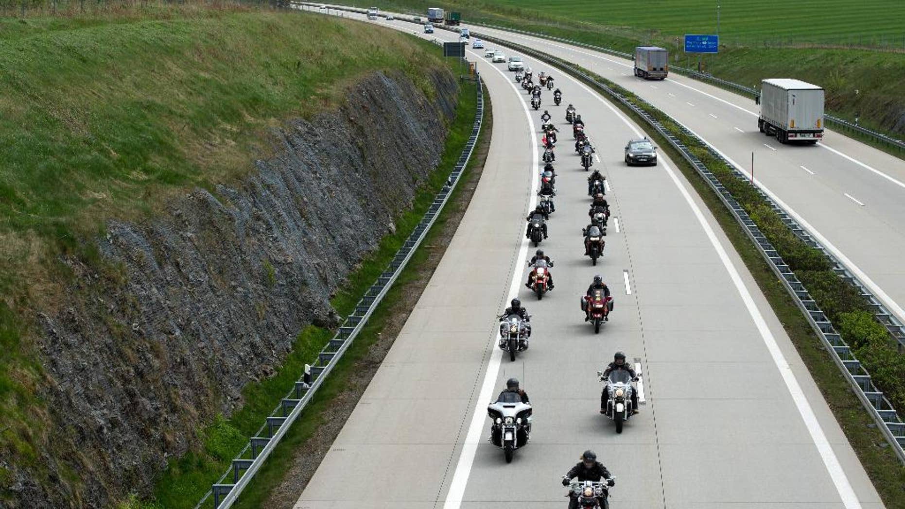 Members of the Russian motorcycle club 'Night wolves' as well as supporters ride their motorbikes along a motorway near Breitenau, Germany, May 7,2015. They are expected to arrive in Berlin on May 9, as part of their tour from Moscow to the German capital. Russia will celebrate the anniversary of the Soviet Union's World War II victory over Nazi Germany on the same day. (Arno Burgi/dpa via AP)