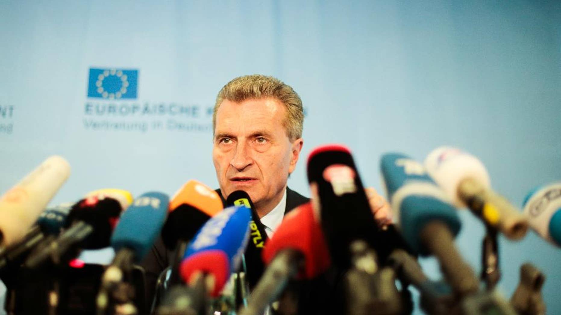 European Union energy commissioner Guenther Oettinger addresses a news conference as part of a meeting of the European Union, Russia's energy minister Alexander Novak and Ukraine's energy minister Yuri Prodan about Ukrainian future gas supply in Berlin, Friday, May 30, 2014. (AP Photo/Markus Schreiber)