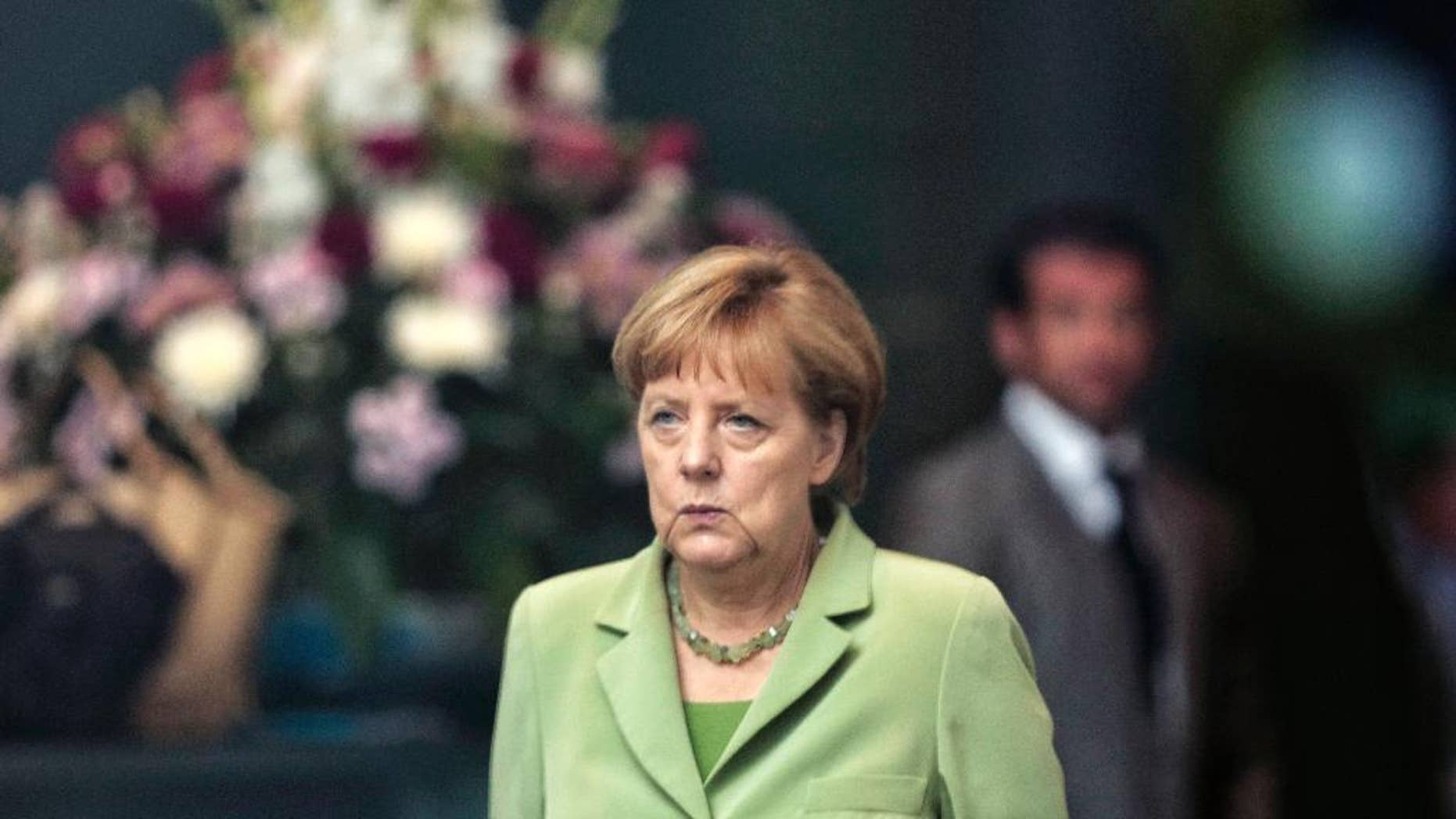 German Chancellor Angela Merkel arrives for the welcoming ceremony of the Prime Minister of Serbia Aleksandar Vucic for talks at the chancellery in Berlin, Wednesday, June 11, 2014. (AP Photo/Markus Schreiber)