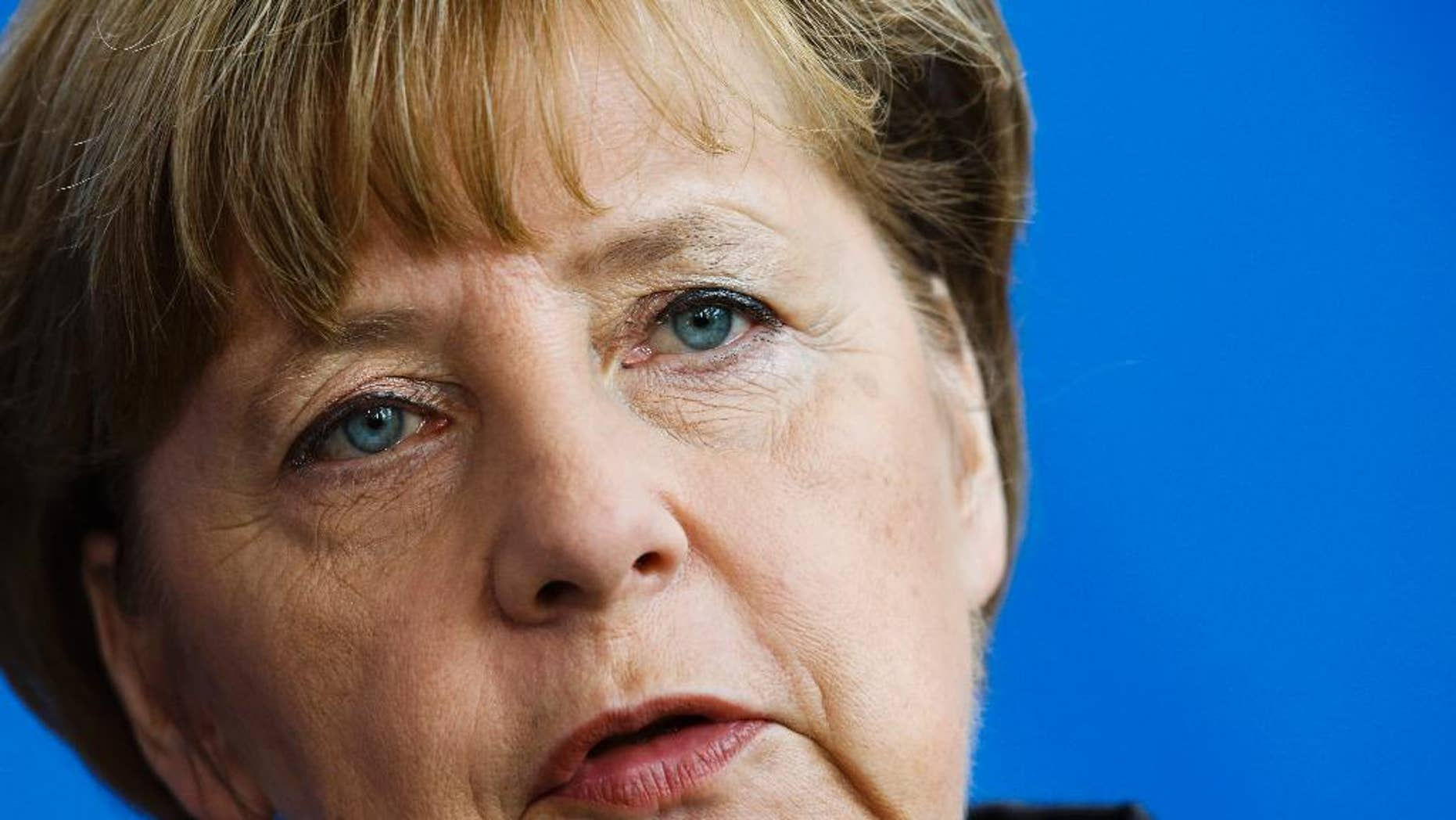 German Chancellor Angela Merkel attends a news conference with the Prime Minister of Sweden Stefan Lofven after a meeting at the chancellery in Berlin, Germany, Wednesday, Feb. 25, 2015.  (AP Photo/Markus Schreiber)