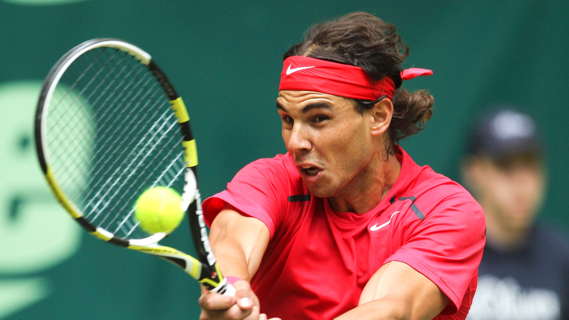 June 14, 2012: Spain's Rafael Nadal  returns a ball during his match against Lukas Lacko from Slovakia at the  Gerry Weber Open, ATP tennis tournament in Halle, Germany.