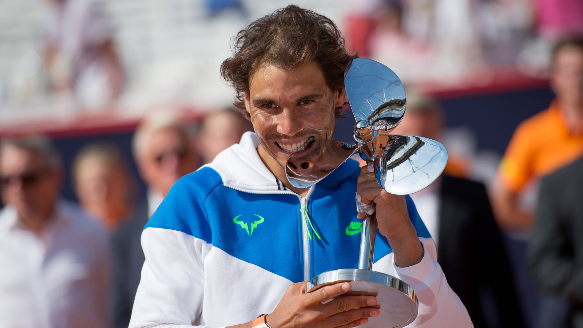 Spain's Rafael Nadal  celebrates with the trophy  after he won  the final match of  the  Hamburg Open ATP tennis tournament  against Fabio Fognini of Italy, in Hamburg, Germany, Sunday Aug. 2, 2015.  (Daniel Reinhardt/dpa via AP)