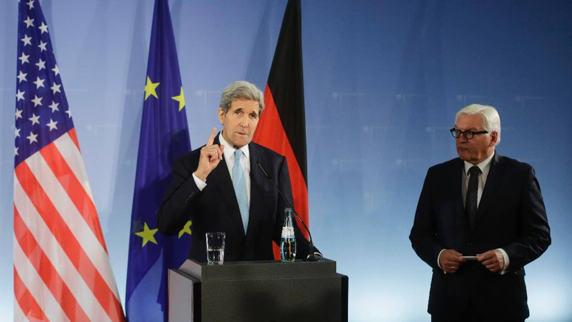U.S. Secretary of State John Kerry, left, and German Foreign Minister Frank-Walter Steinmeier brief the media prior to a meeting at the foreign ministry Auswaertiges Amt in Berlin, Germany, Thursday, Oct. 22, 2015. (AP Photo/Markus Schreiber)