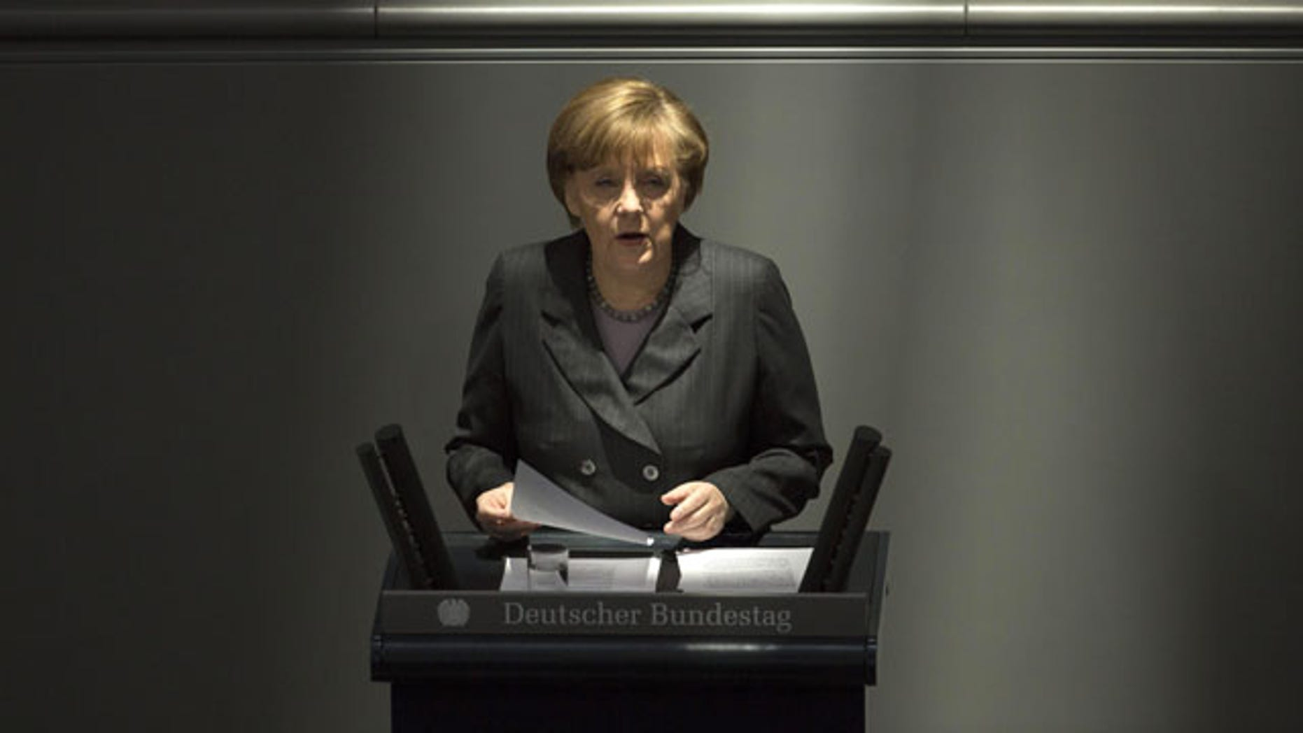 """March 13, 2014: German Chancellor Angela Merkel delivers a speech on the Ukrainian crisis at the parliament Bundestag in Berlin, in which she warned Moscow that if it continues its current course in the Ukraine crisis, Russia risks """"massive"""" political and economic consequences. (AP Photo/Markus Schreiber)"""