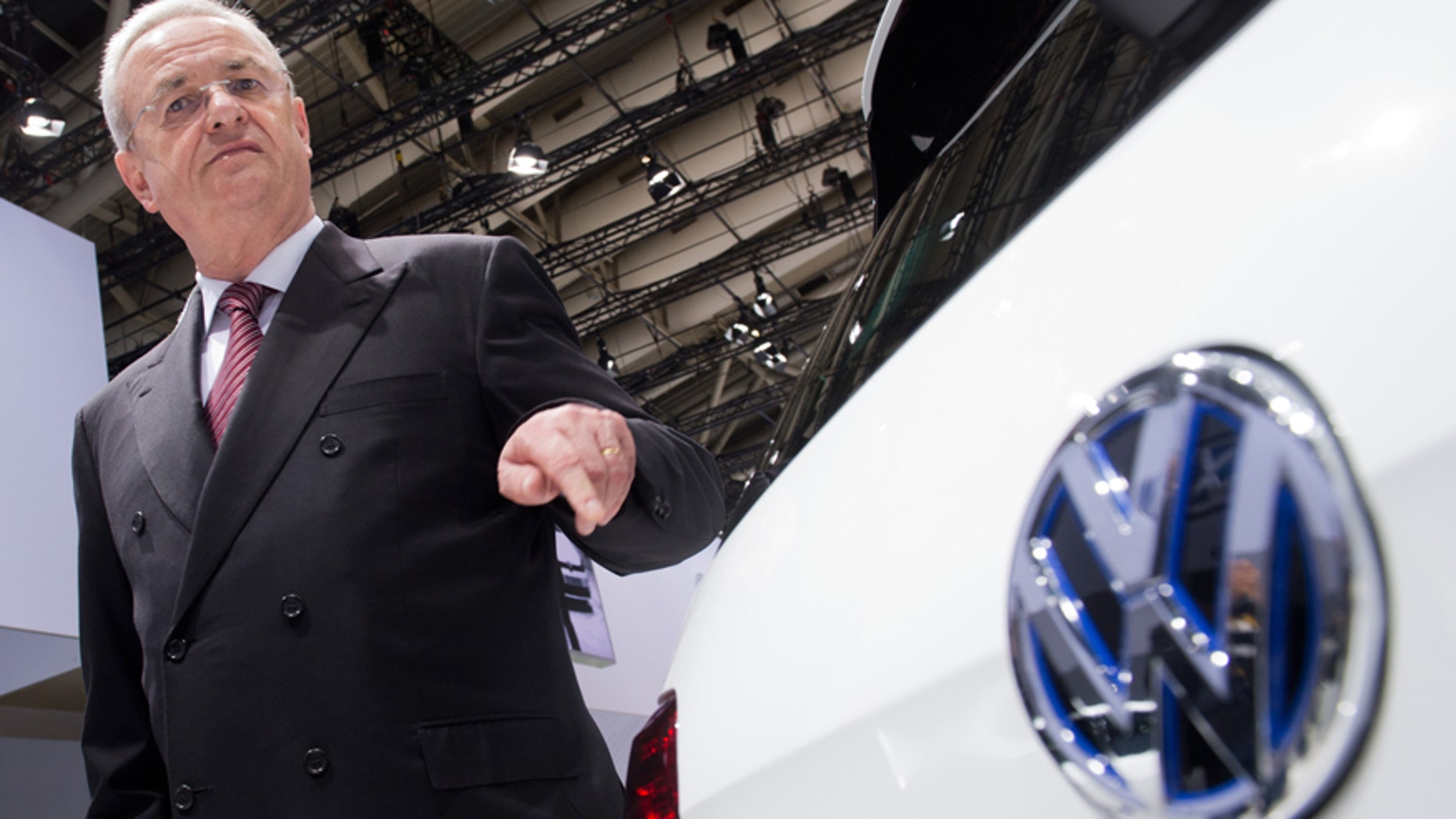 FILE  In this May 13, 2014 file picture then Volkswagen CEO , Martin Winterkorn, stands next to a VW car  at the annual shareholder meeting in Hannover, Germany.   German prosecutors said Monday June 20, 2016  they have opened an investigation of former Volkswagen CEO Martin Winterkorn on allegations of market manipulation in connection with the company's scandal over cars rigged to cheat on U.S. diesel emissions tests.  ( Julian Stratenschulte/dpa via AP,file)