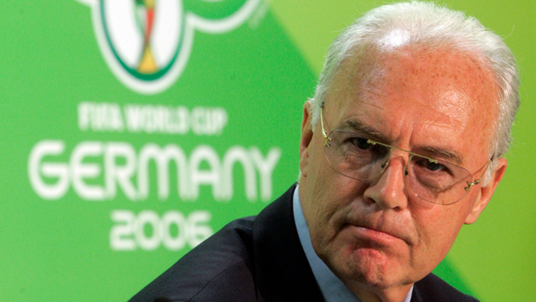 FILE - In this June 29, 2006 file picture Franz Beckenbauer, then President of the German Organization Committee of the soccer World Cup briefs the media during a news conference at the Olympic Stadium in Berlin.  A highly anticipated independent report to be released Friday March 4, 2016 could throw light into corruption allegations against Germany's 2006 World Cup organizers and the fate of a dubious payment to FIFA.  (AP Photo/Markus Schreiber,file)