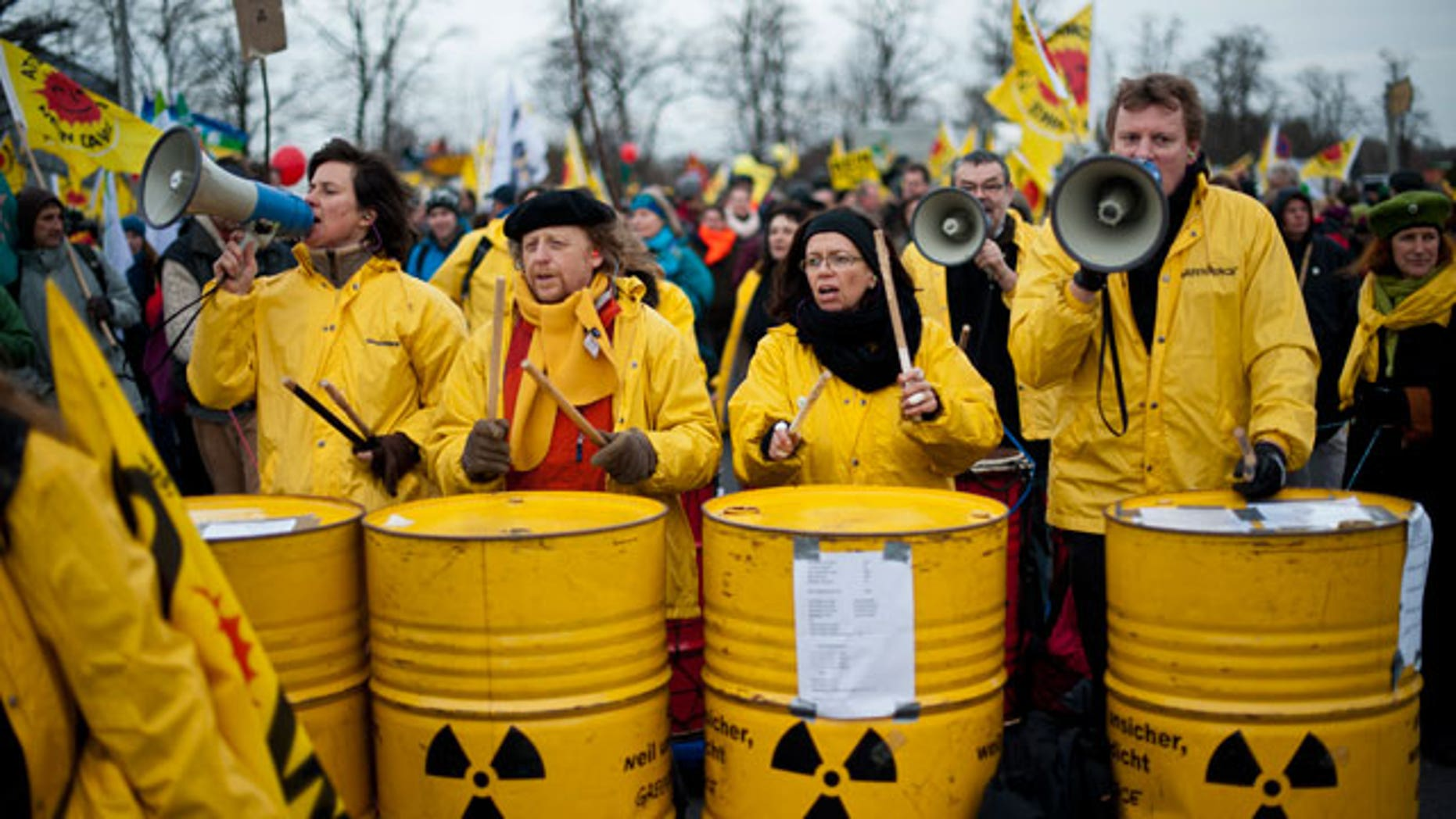 Nov. 26, 2011: Demonstrators drum on barrels with a nuclear sign, during protests against a nuclear waste transport in Dannenberg, northern Germany.