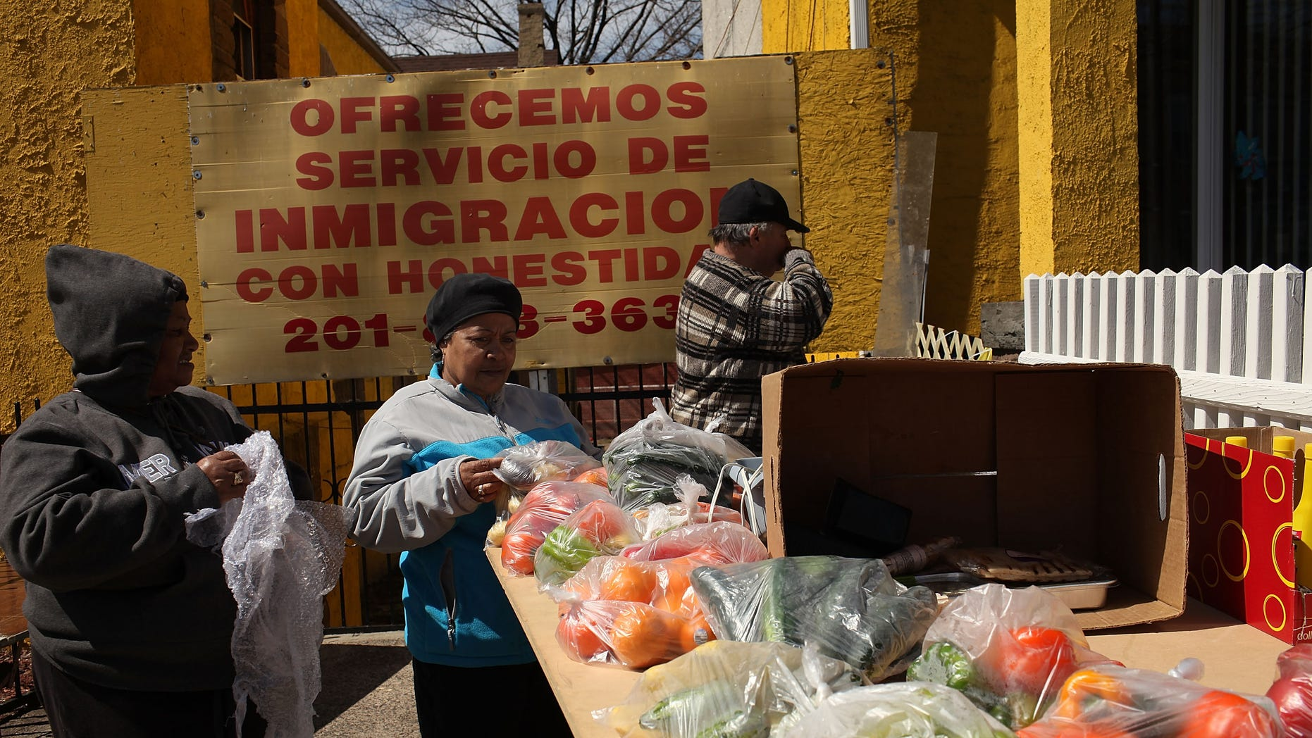 Hispanic women shop at a farmers market outside of a Latino church in Union City, New Jersey.