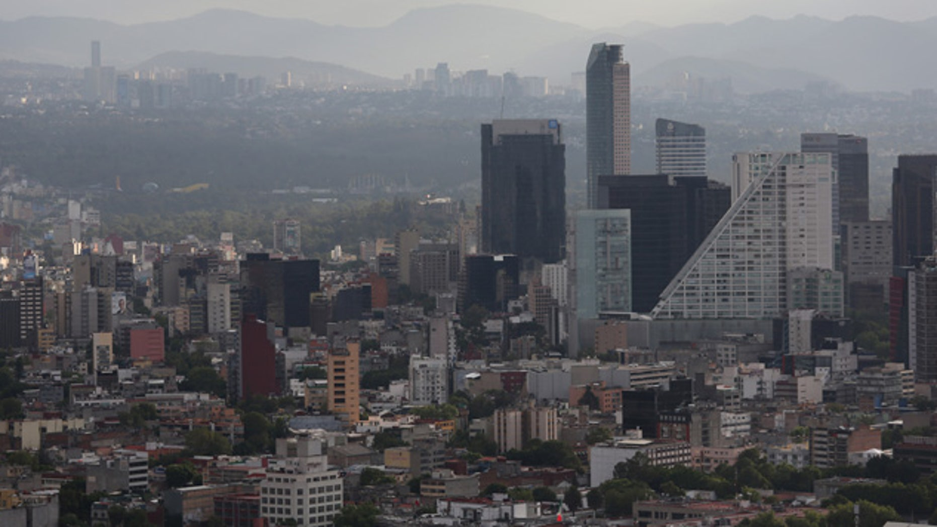 Mexico City skyline is seen through the haze from the Latino Tower in Mexico City, Mexico.  (Photo by John Moore/Getty Images)