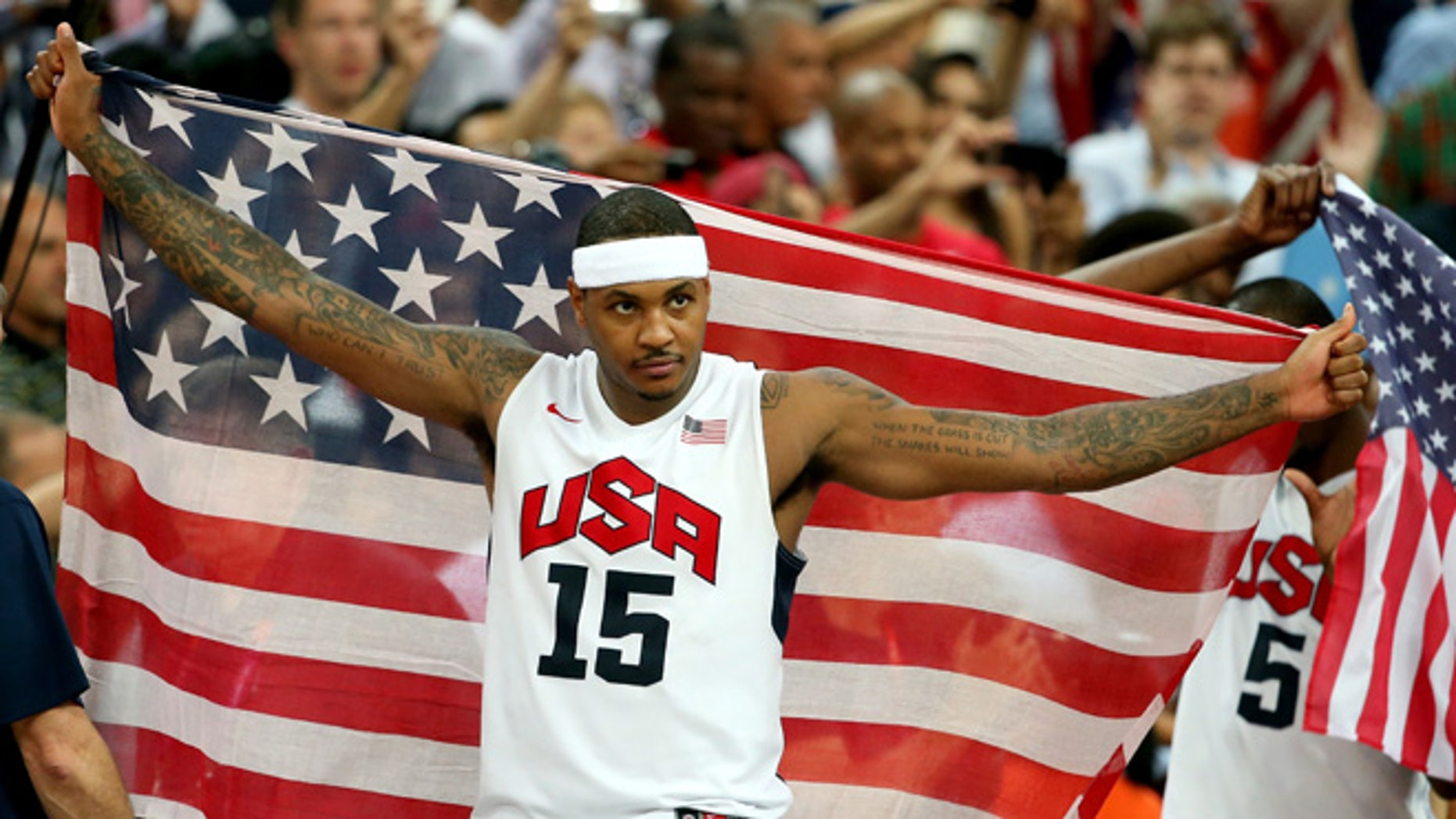 LONDON, ENGLAND - AUGUST 12: Carmelo Anthony #15 of the United States celebrates winning the Men's Basketball gold medal game between the United States and Spain on Day 16 of the London 2012 Olympics Games at North Greenwich Arena on August 12, 2012 in London, England. The United States won the match 107-100.  (Photo by Christian Petersen/Getty Images)