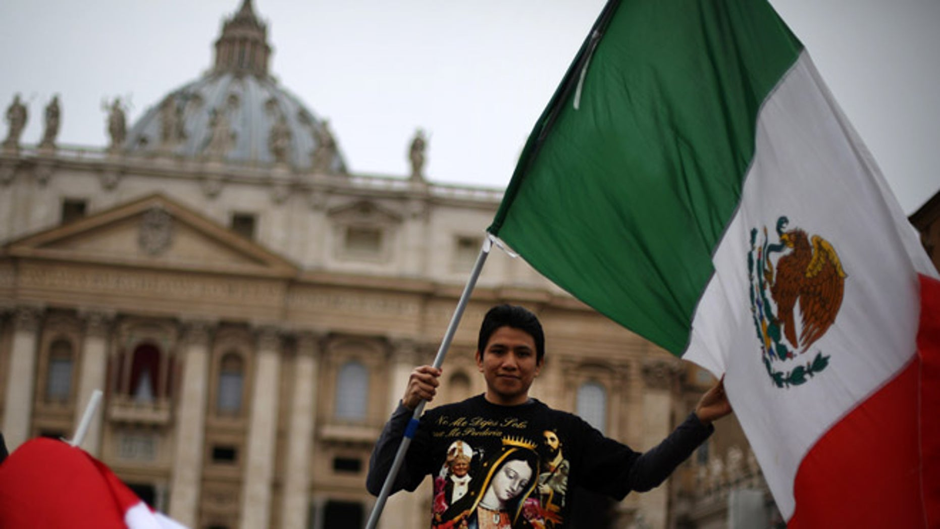 VATICAN CITY, VATICAN - MARCH 17:  A boy waves the flag of Mexico in St Peter's Square after Pope Francis gave his first Angelus blessing on March 17, 2013 in Vatican City, Vatican. The Vatican is preparing for the inauguration of Pope Francis on March 19, 2013 in St Peter's Square.  (Photo by Peter Macdiarmid/Getty Images)