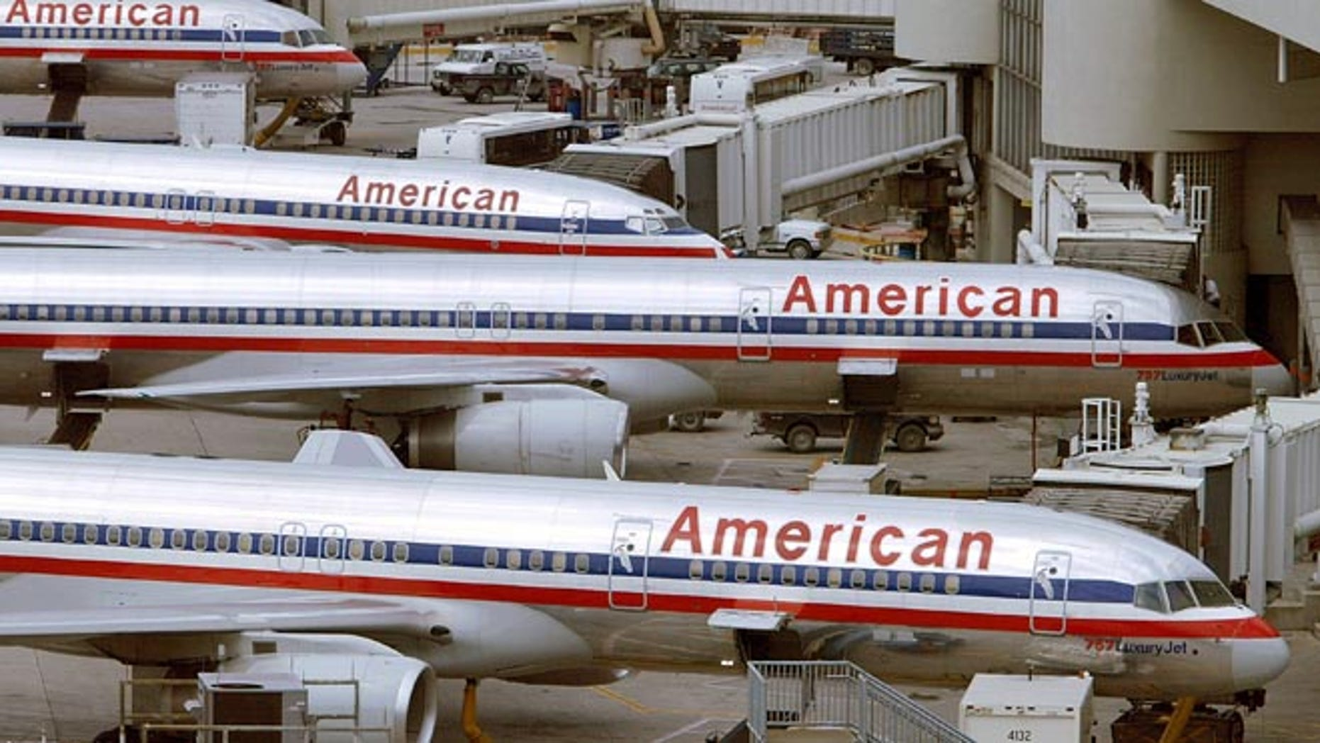 MIAMI - OCTOBER 16:  (FILE PHOTO)  American Airlines planes sit at a Miami International Airport terminal October 16, 2002 in Miami, Florida. Airline officials announced April 2, 2003 that a lay off of approximately 2,500 pilots will occur over the next year to try and prevent bankruptcy.  (Photo by Joe Raedle/Getty Images)