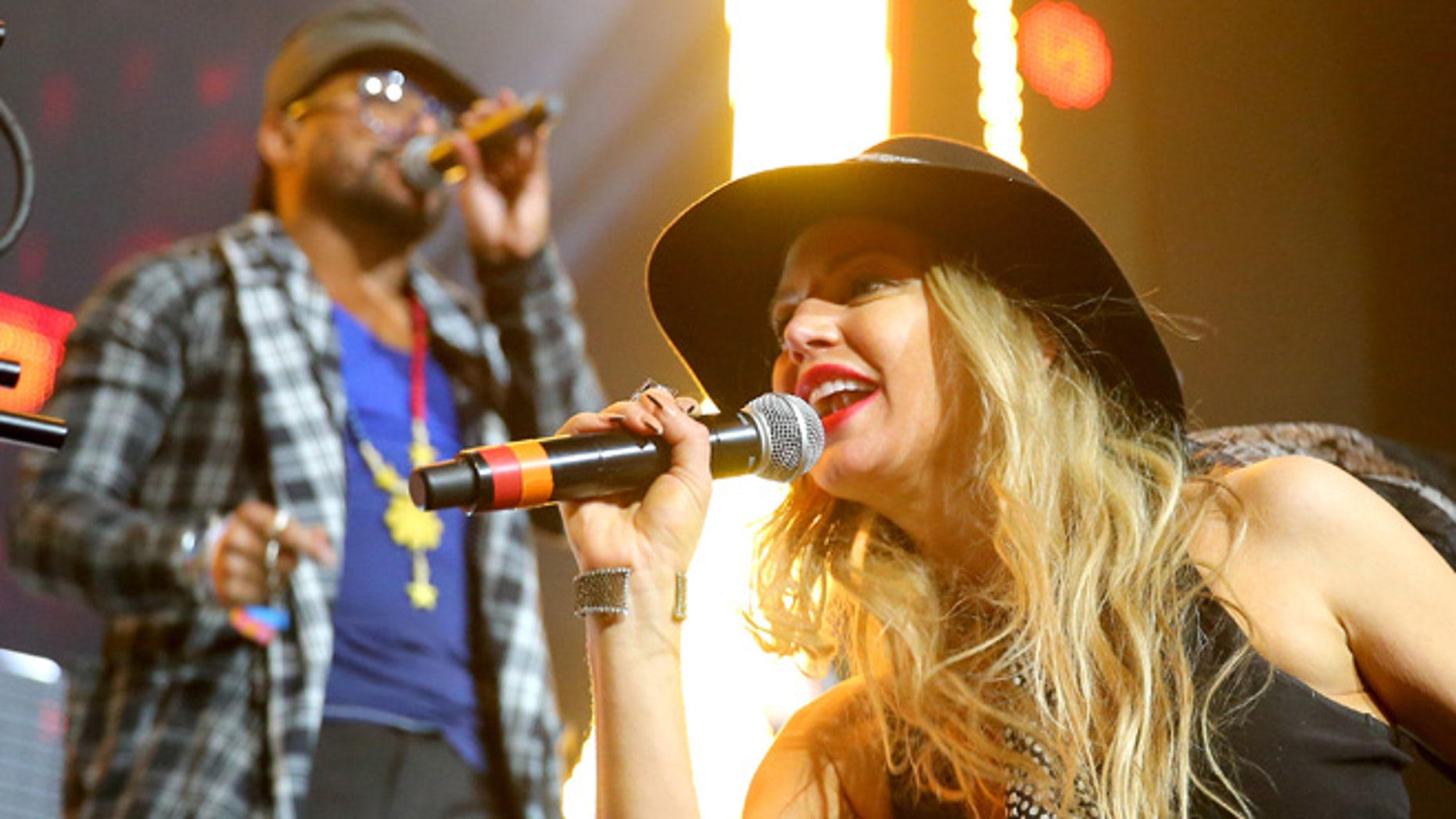 INDIO, CA - APRIL 12:  Recording artists will.i.am (L) and Fergie of The Black Eyed Peas perform onstage with David Guetta during day 3 of the 2015 Coachella Valley Music & Arts Festival (Weekend 1) at the Empire Polo Club on April 12, 2015 in Indio, California.  (Photo by Mark Davis/Getty Images for Coachella)
