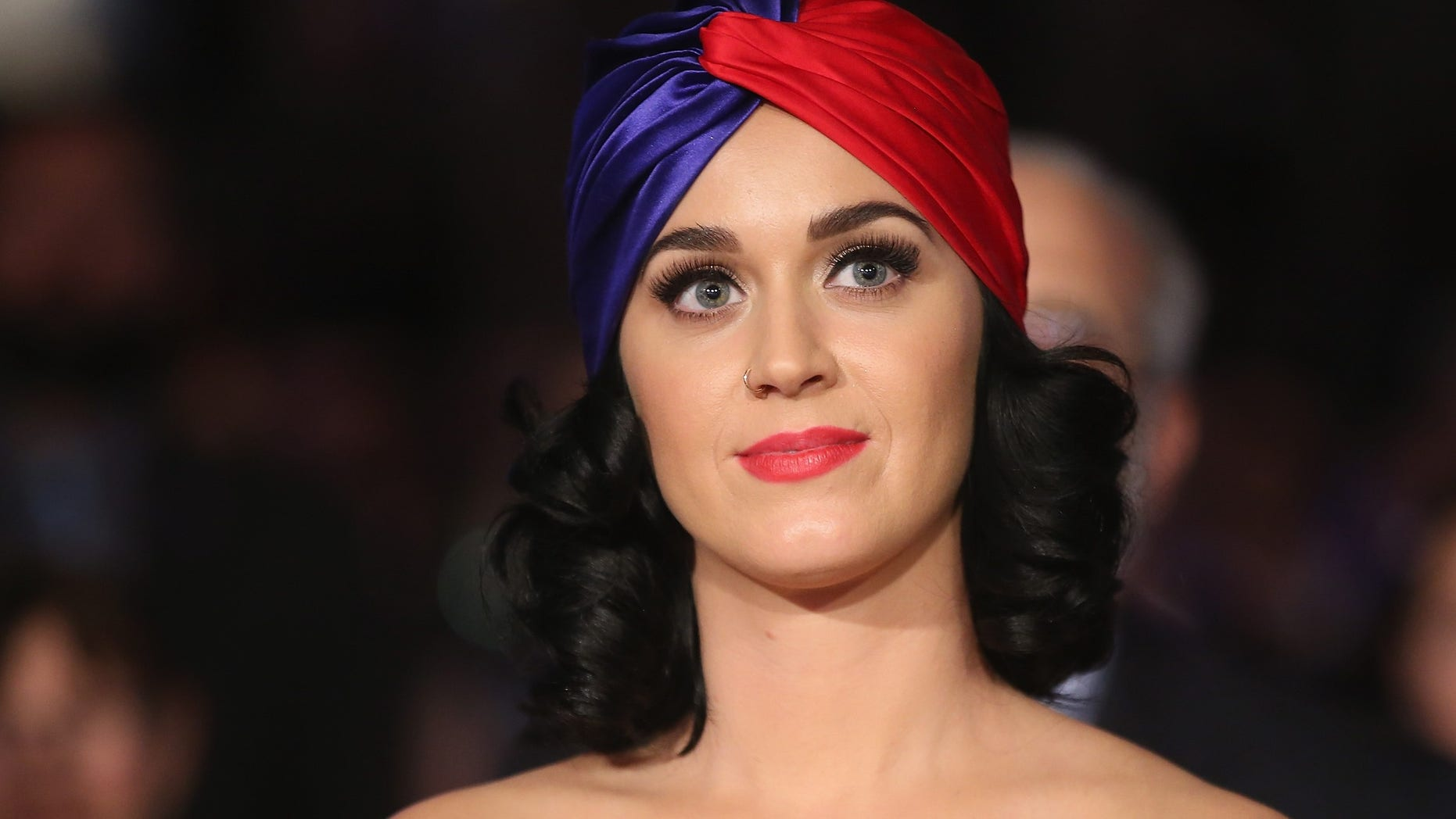 Katy Perry gives Hillary Clinton a presidential birthday gift. (Photo by Scott Olson/Getty Images)