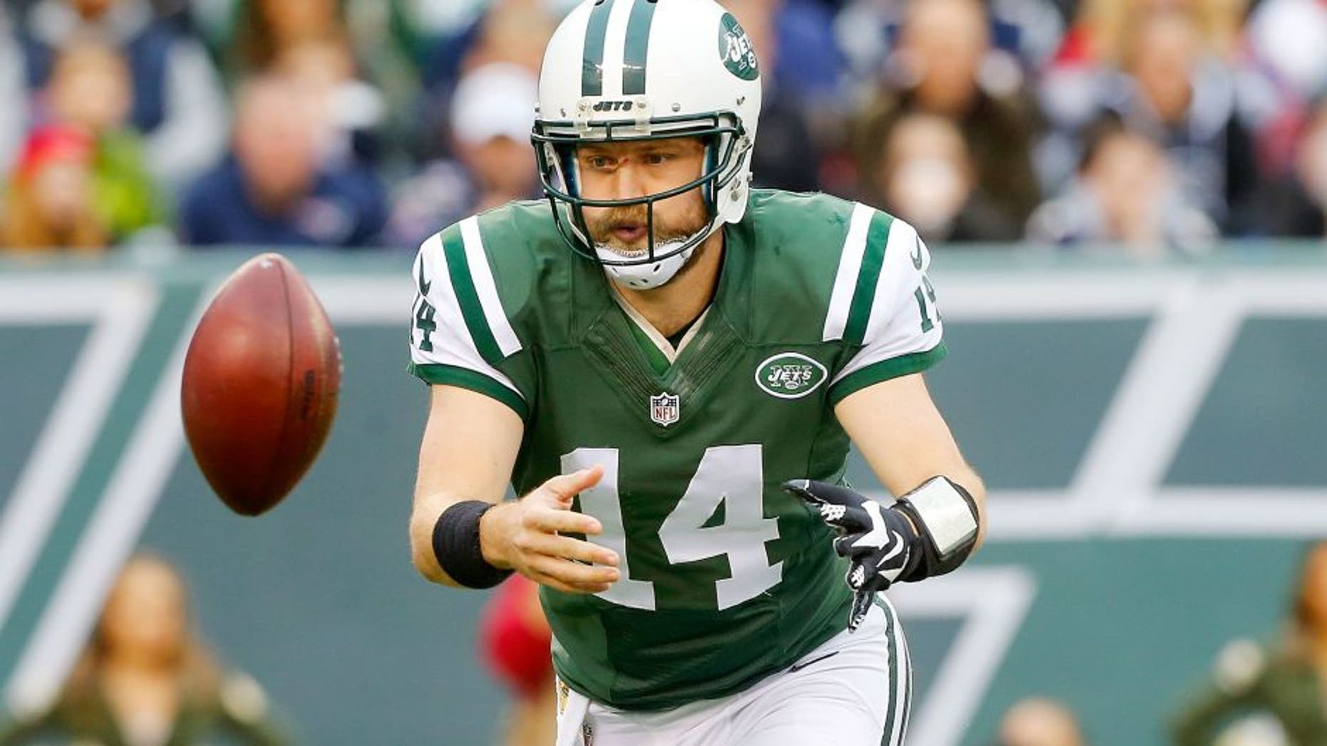 EAST RUTHERFORD, NJ - DECEMBER 27: (NEW YORK DAILIES OUT) Ryan Fitzpatrick #14 of the New York Jets in action against the New England Patriots on December 27, 2015 at MetLife Stadium in East Rutherford, New Jersey. The Jets defeated the Patriots 26-20 in overtime. (Photo by Jim McIsaac/Getty Images)