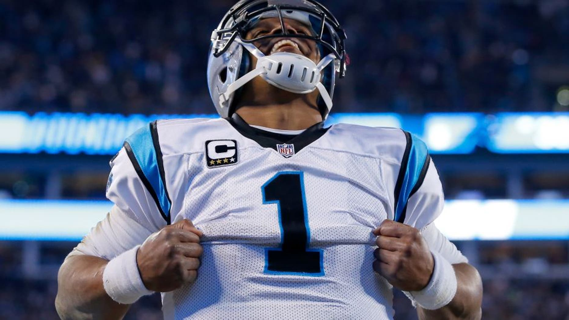 CHARLOTTE, NC - JANUARY 24: Cam Newton #1 of the Carolina Panthers celebrates after scoring a touchdown in the third quarter against the Arizona Cardinals during the NFC Championship Game at Bank of America Stadium on January 24, 2016 in Charlotte, North Carolina. (Photo by Kevin C. Cox/Getty Images)