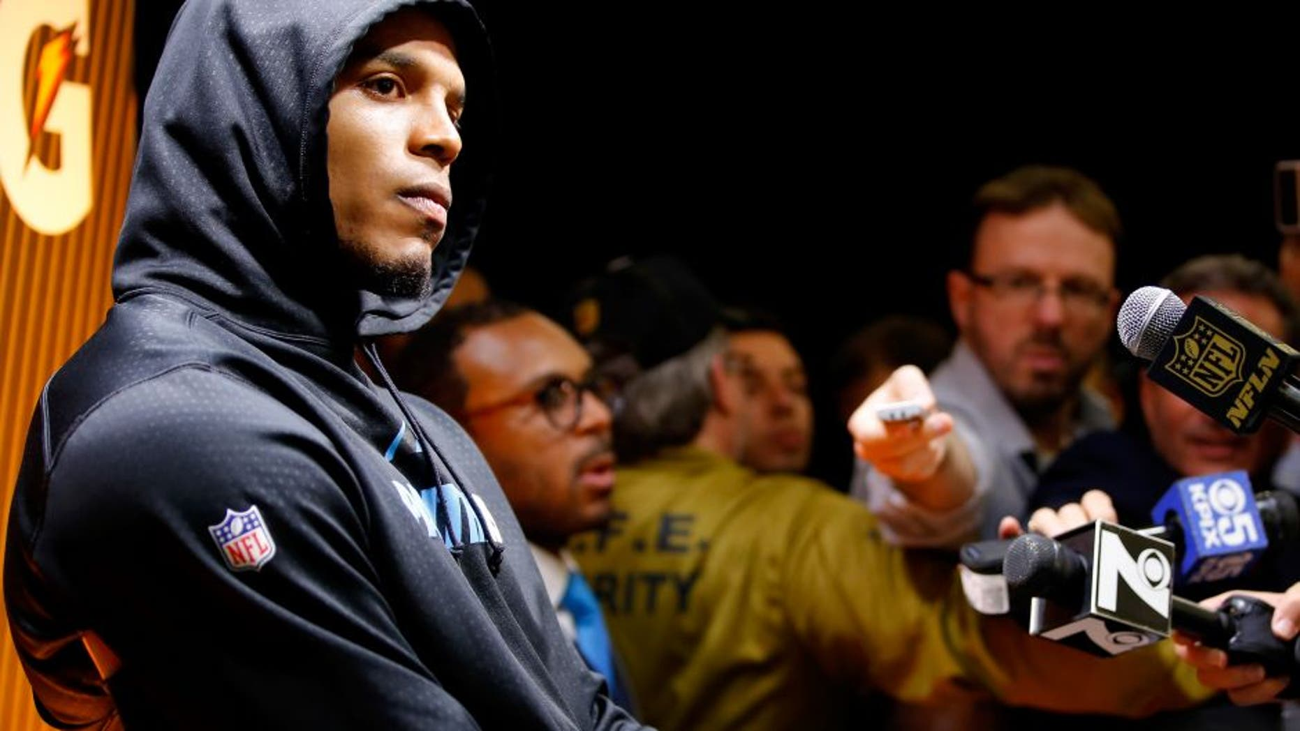 SANTA CLARA, CA - FEBRUARY 07: Cam Newton #1 of the Carolina Panthers reacts during his postgame press conference after the Denver Broncos defeated the Carolina Panthers with a score of 24 to 10 to win Super Bowl 50 at Levi's Stadium on February 7, 2016 in Santa Clara, California. (Photo by Kevin C. Cox/Getty Images)