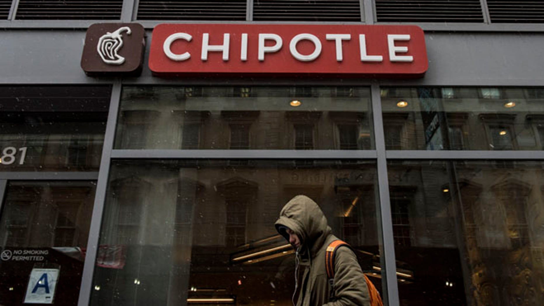 NEW YORK, NEW YORK -- FEBRUARY 8:  A man walks past an empty Chipotle restaurant on Broadway in Lower Manhattan on February 8, 2016 in New York City. The Mexican food chain is closing stores for lunch nationwide for a meeting on food safety following a number of E. coli outbreaks. (Photo by Andrew Renneisen/Getty Images)