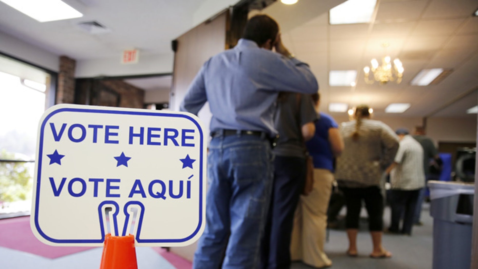 ROSENBERG, TEXAS - MARCH 1:  Voters stand in line to cast their ballots inside Calvary Baptist Church March 1, 2016 in Rosenberg, Texas. Voters in 12 states go to the polls in today's Super Tuesday.  (Photo by Erich Schlegel/Getty Images)
