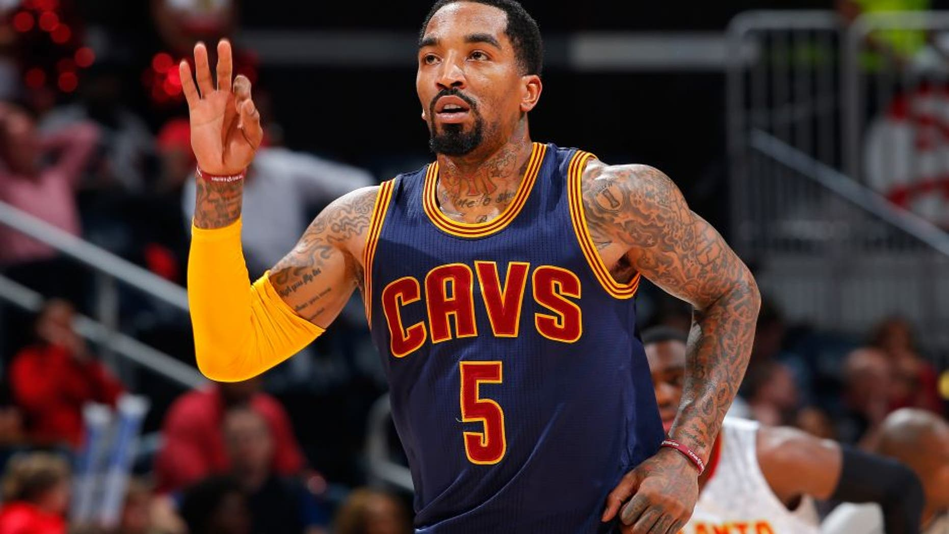 ATLANTA, GEORGIA - APRIL 01: J.R. Smith #5 of the Cleveland Cavaliers reacts after hitting a three-point basket against the Atlanta Hawks at Philips Arena on April 1, 2016 in Atlanta, Georgia. NOTE TO USER User expressly acknowledges and agrees that, by downloading and or using this photograph, user is consenting to the terms and conditions of the Getty Images License Agreement. (Photo by Kevin C. Cox/Getty Images)