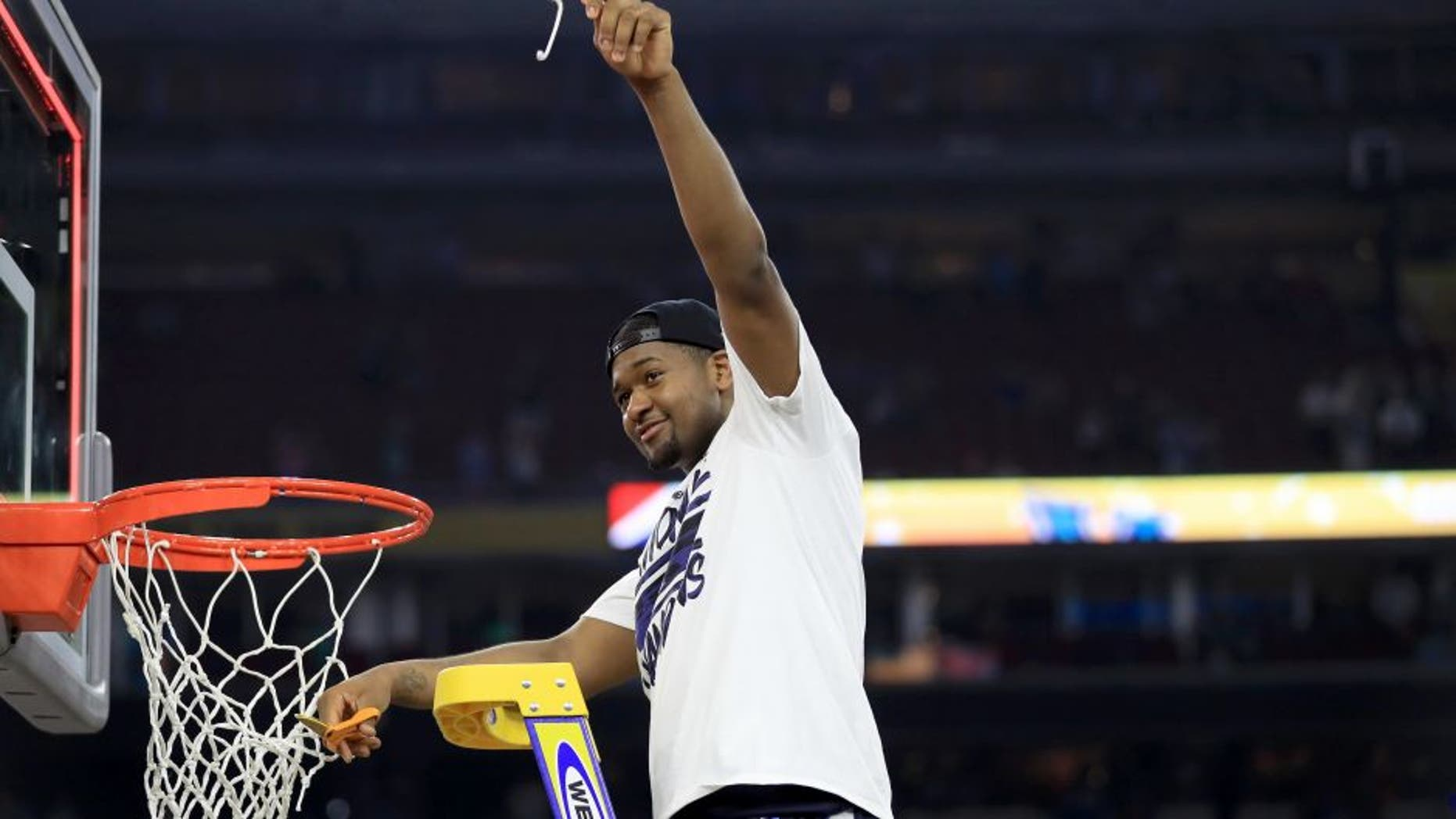 HOUSTON, TEXAS - APRIL 04: Kris Jenkins #2 of the Villanova Wildcats cuts the net after defeating the North Carolina Tar Heels 77-74 to win the 2016 NCAA Men's Final Four National Championship game at NRG Stadium on April 4, 2016 in Houston, Texas. (Photo by Ronald Martinez/Getty Images)