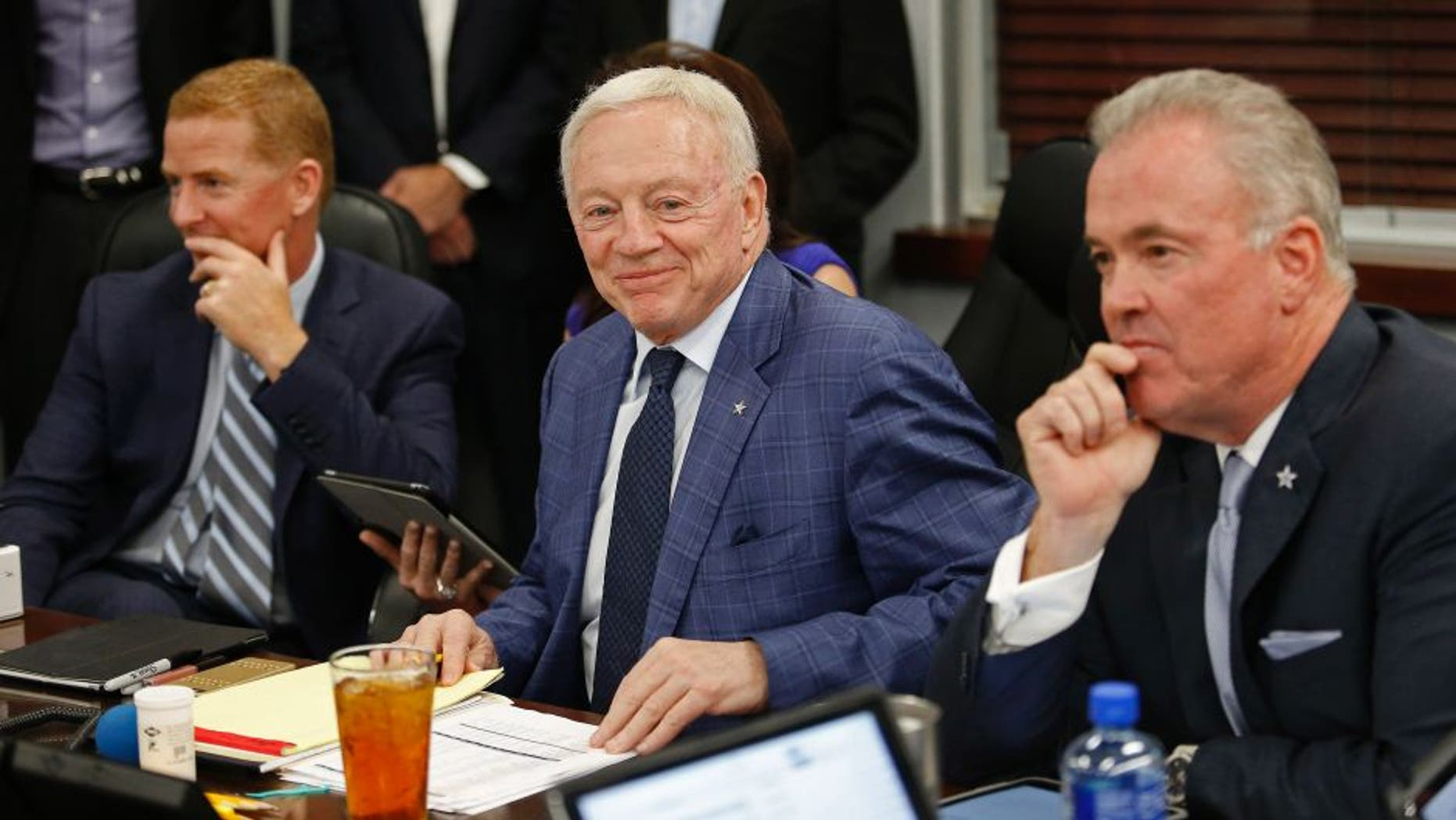 """Dallas Cowboys head coach Jason Garrett, left, team owner Jerry Jones and Stephen Jones, right, in the """"War Room"""" as the Cowboys take part in the NFL Draft on Thursday, April 28, 2016, at the team Headquarters at Valley Ranch in Irving, Texas. (Paul Moseley/Fort Worth Star-Telegram/TNS via Getty Images)"""