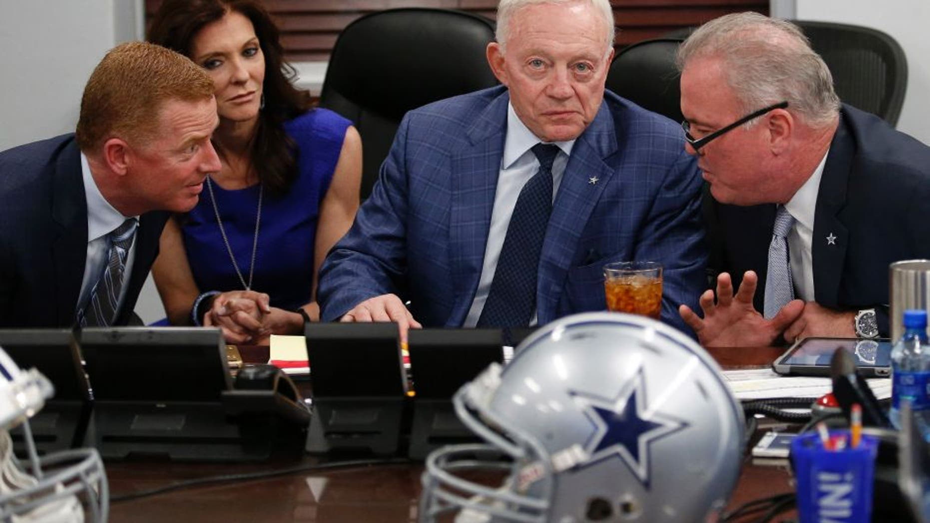 """Dallas Cowboys executives in the """"War Room"""" with head coach Jason Garrett, left, and team principals Charlotte Jones Anderson, owner Jerry Jones and Stephen Jones, right, as the Cowboys take part in the NFL Draft on Thursday, April 28, 2016, at the team Headquarters at Valley Ranch in Irving, Texas. (Paul Moseley/Fort Worth Star-Telegram/TNS via Getty Images)"""