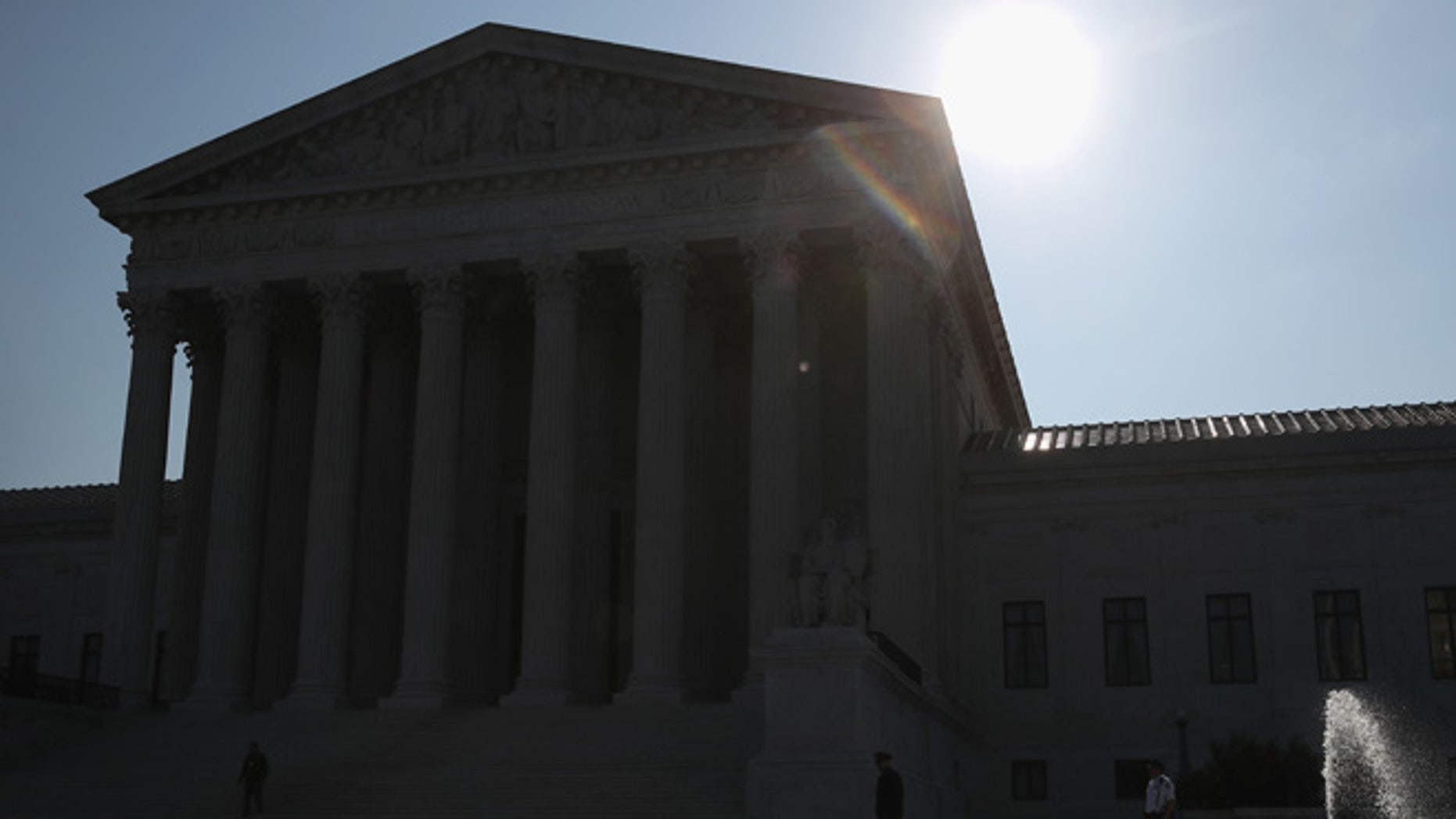 WASHINGTON, DC - MAY 16:  The early morning sun rises behind the U.S. Supreme Court building May 15, 2016 in Washington, DC. Today the high court sent the Affordable Care Act's contraceptive mandate case back down to the lower courts for opposing parties to work out a compromise.  (Photo by Mark Wilson/Getty Images)