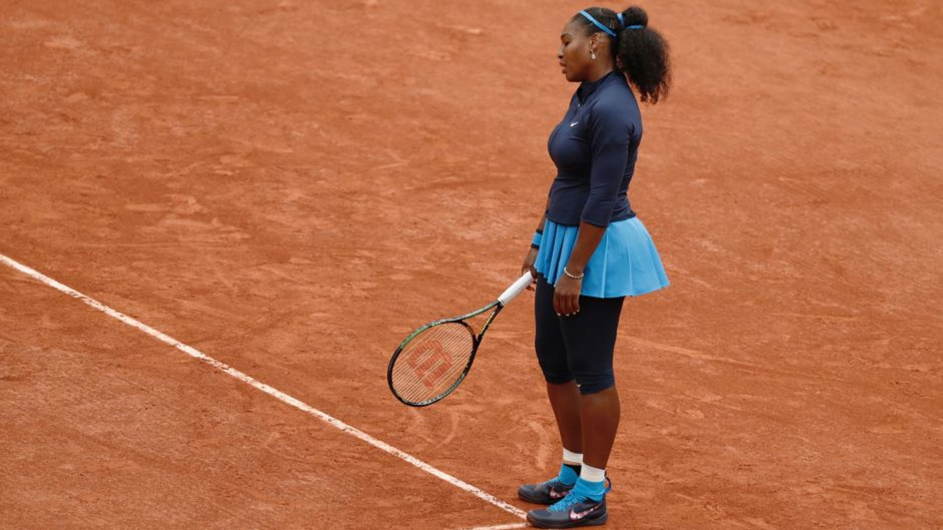 The US's Serena Williams reacts during her women's final match against Spain's Garbine Muguruza at the Roland Garros 2016 French Tennis Open in Paris on June 4, 2016. / AFP / Thomas SAMSON (Photo credit should read THOMAS SAMSON/AFP/Getty Images)