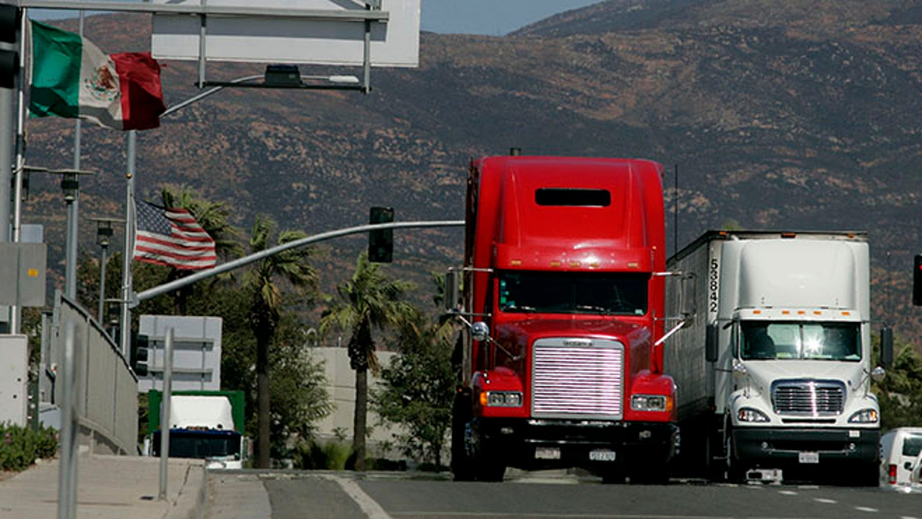 OTAY MESA, CA-MARCH 24:  Trucks coming from Mexico prepare to enter the highway after crossing the border March 24, 2009 in Otay Mesa, California.  Mexico last week slapped higher tariffs on an estimated $2.4 billion worth of goods entering the country from the U.S. in response to a move by Congress  to end a pilot program allowing Mexican trucks to operate in the U.S.  (Photo by Sandy Huffaker/Getty Images)