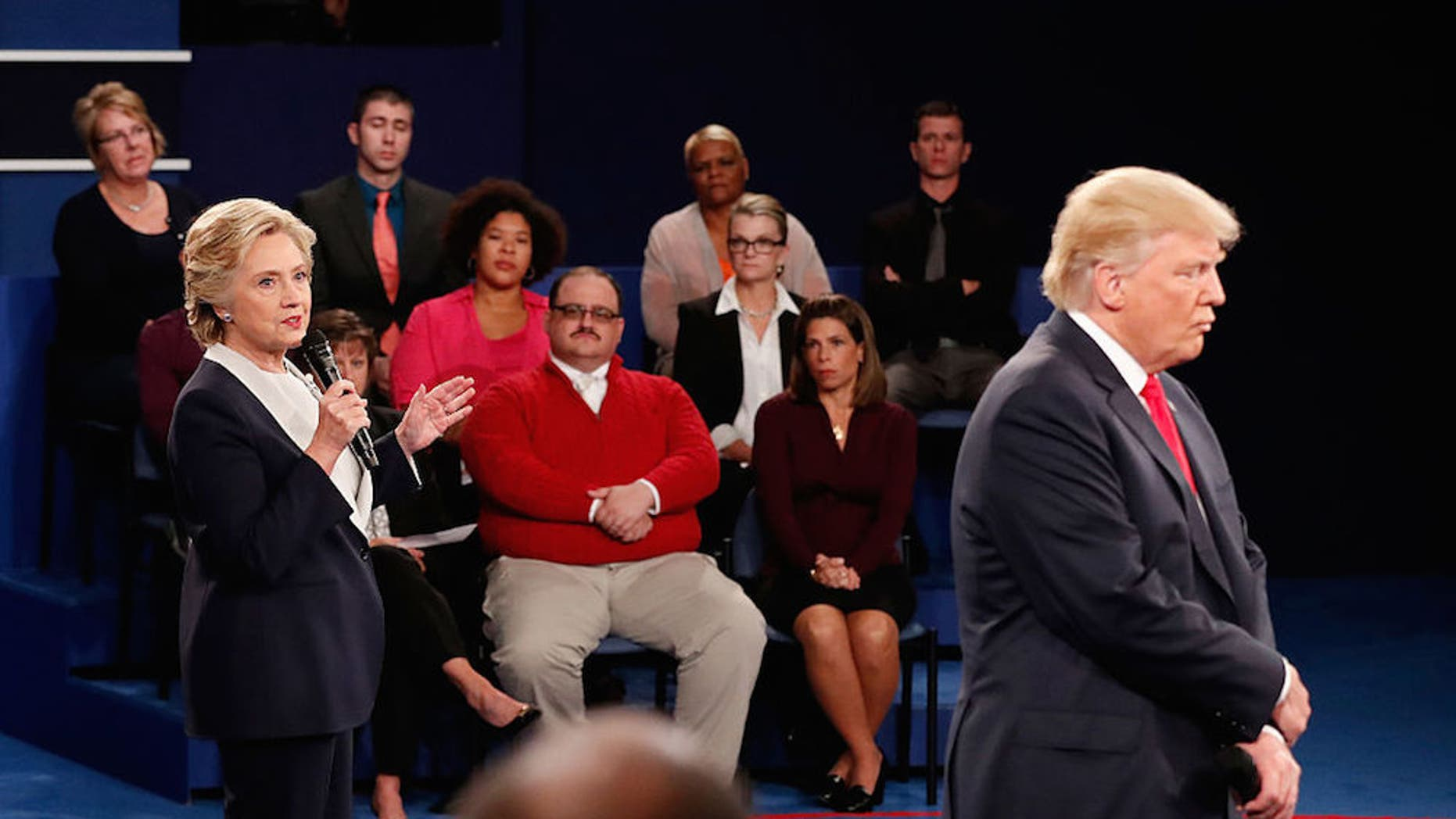 Hillary Clinton (left) and Donald Trump (right) share their positions while Ken Bone (center) listens at the town hall debate on Saturday (Oct. 9).