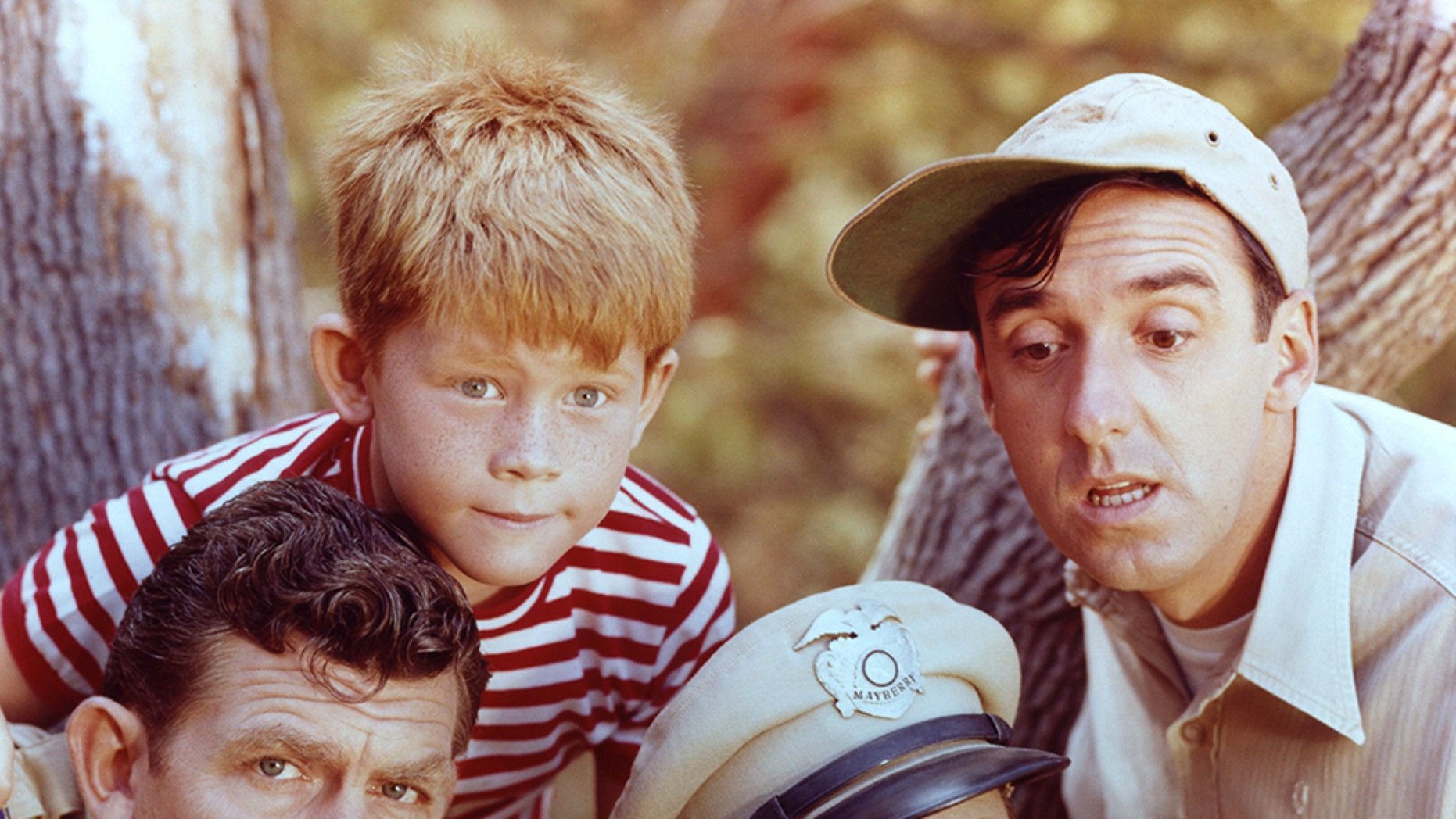 """Andy Griffith as Sheriff Andy Taylor, Jim Nabors as Gomer Pyle, Ron Howard as Opie Taylor and Don Knotts as Deputy Barney Fife in """"The Andy Griffith Show,"""" circa 1963."""