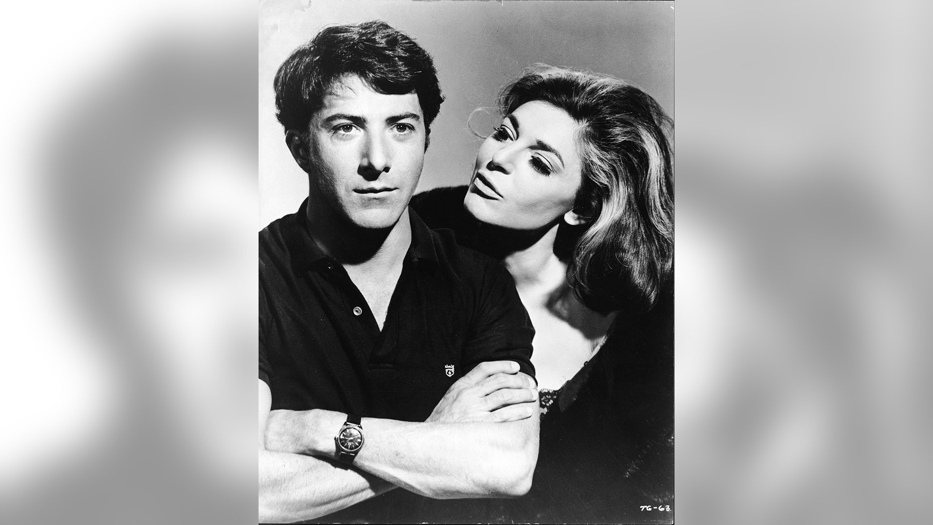 """American actress Anne Bancroft (1931 - 2005), in character as the seductive older woman Mrs. Robinson, looks at American actor Dustin Hoffman, as Benjamin Braddock, in a publicity still from the film """"The Graduate"""" directed by Mike Nichols, California, 1967."""