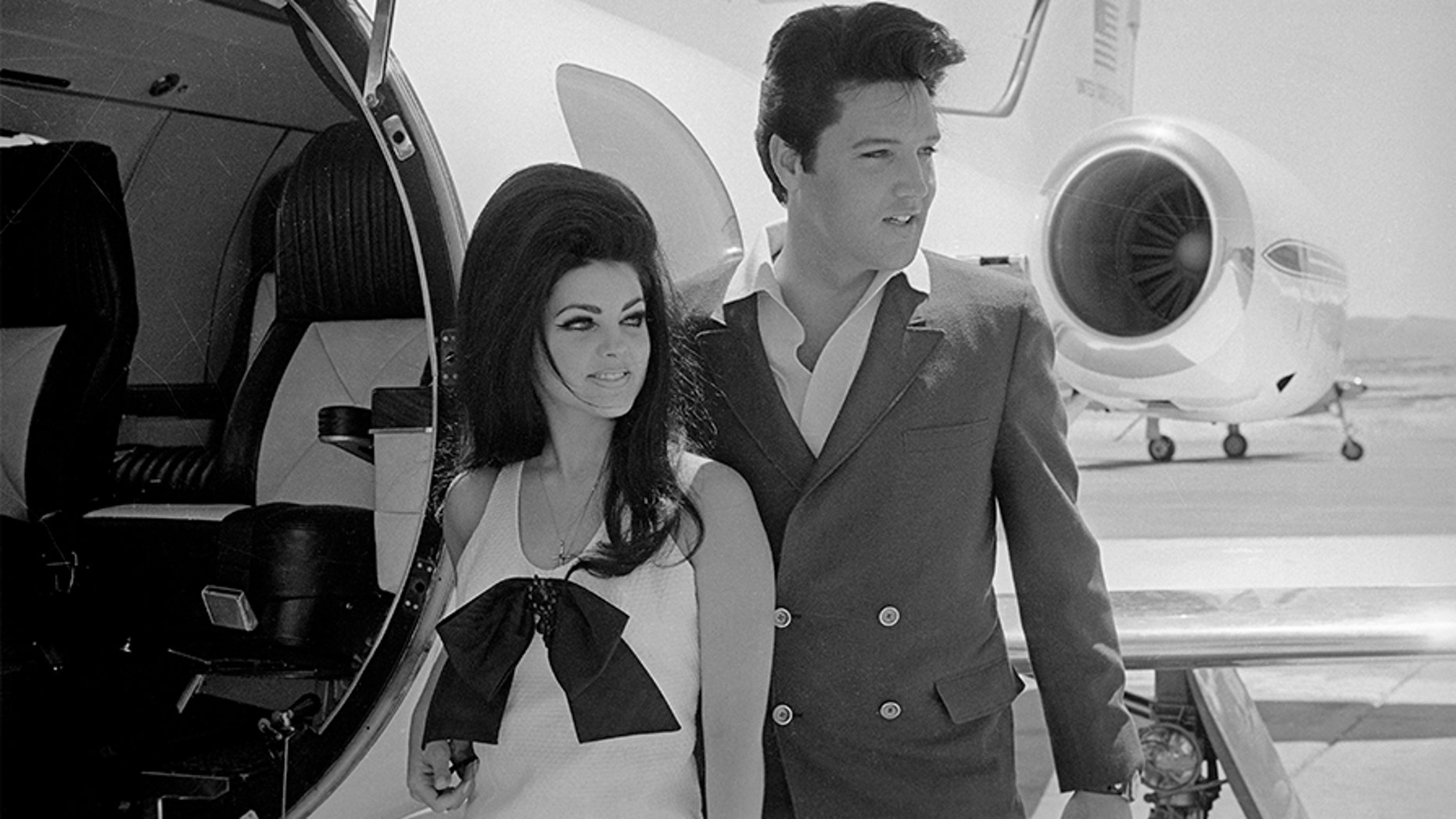 Newlyweds Elvis and Priscilla Presley, who met while Elvis was in the Army, prepare to board their private jet following their wedding at the Aladdin Resort and Casino in Las Vegas