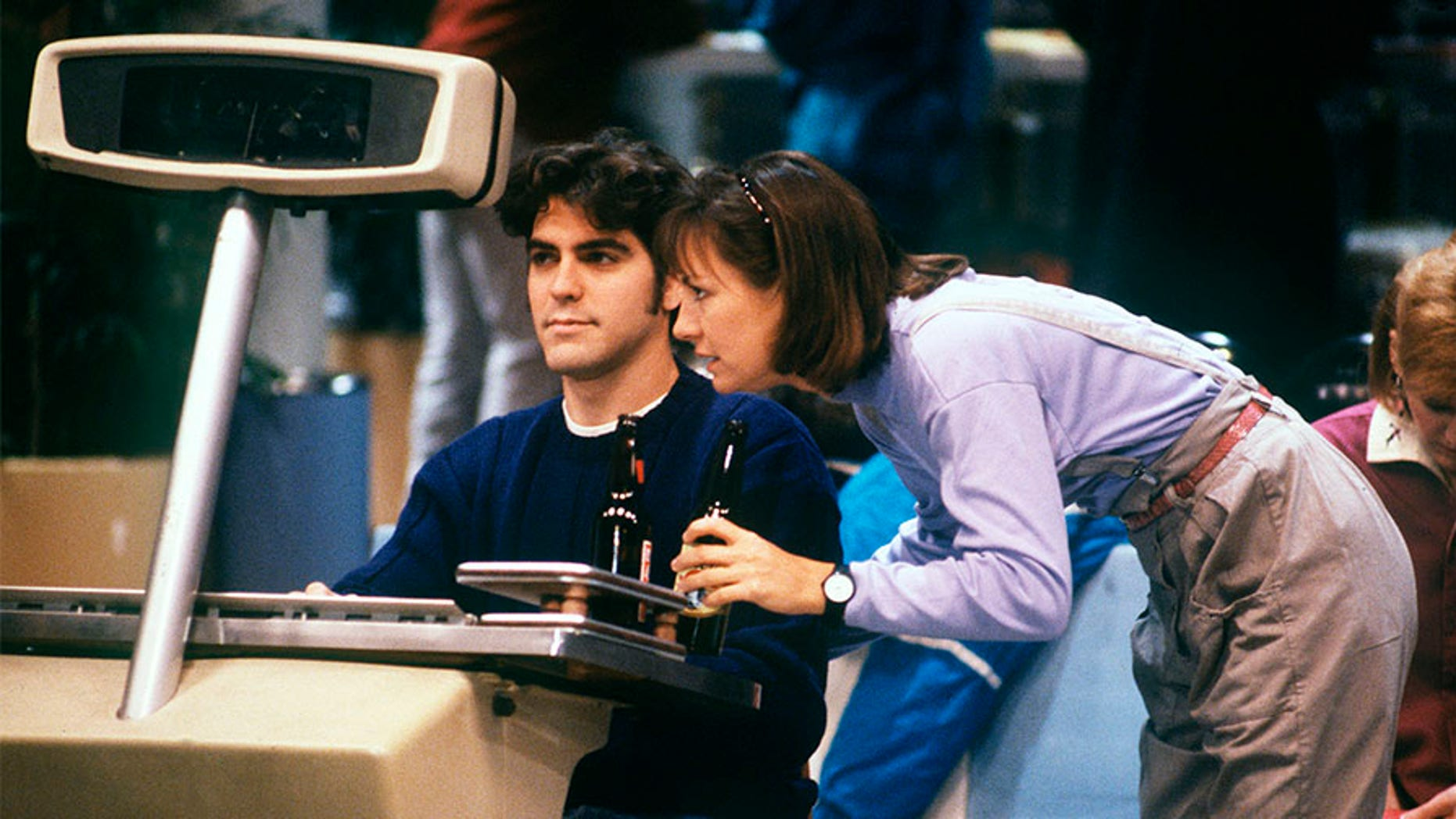 """In this 1988 episode of """"Roseanne,"""" Jackie (Laurie Metcalf) had a salacious bet on the line with Booker (George Clooney) on bowling night."""