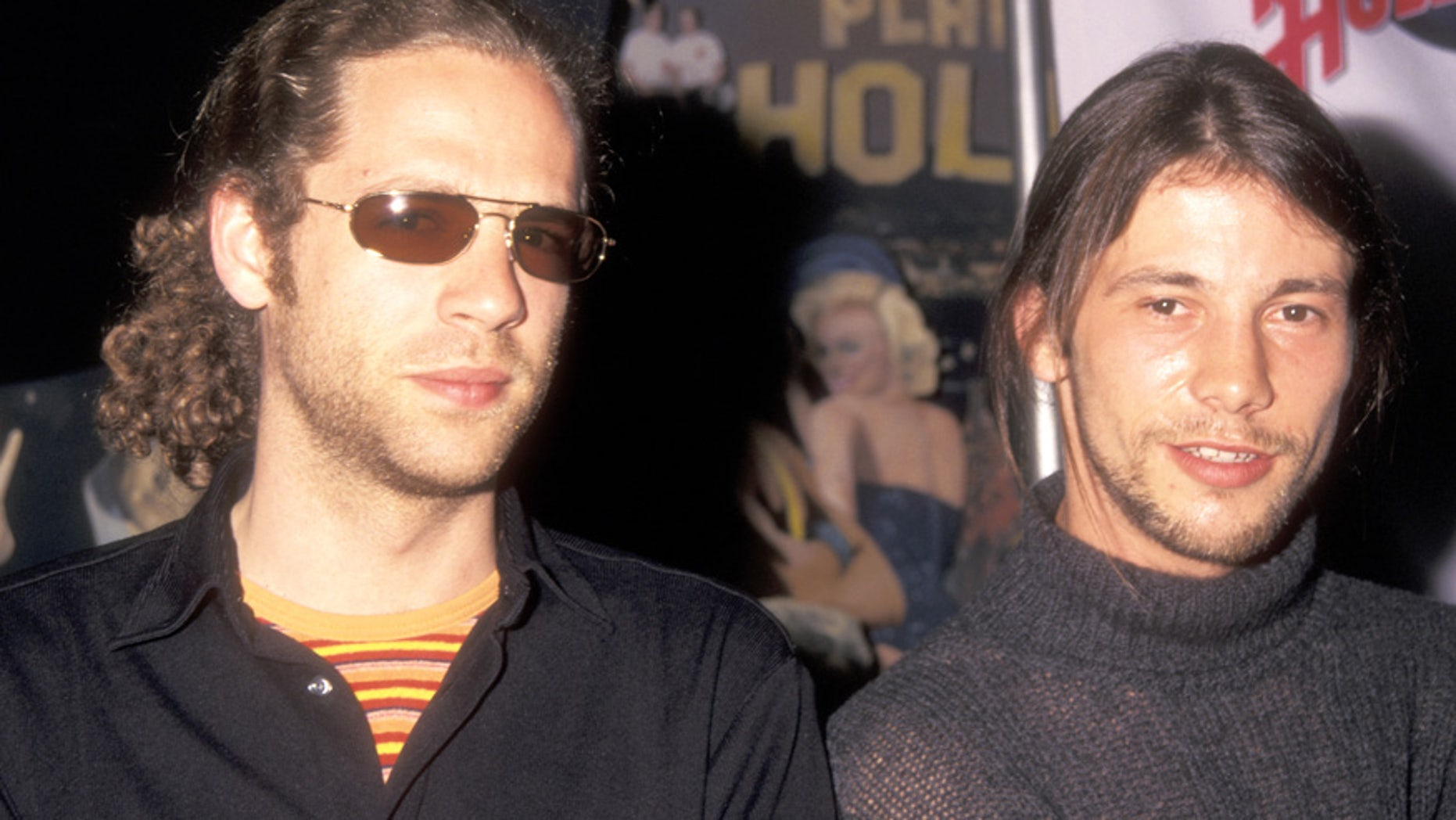 """Toby Smith and Jason Kay of the funk/rock band Jamiroquai attend the press conference to announce release of the """"Godzilla"""" soundtrack on May 18, 1998 at Planet Hollywood in New York City."""