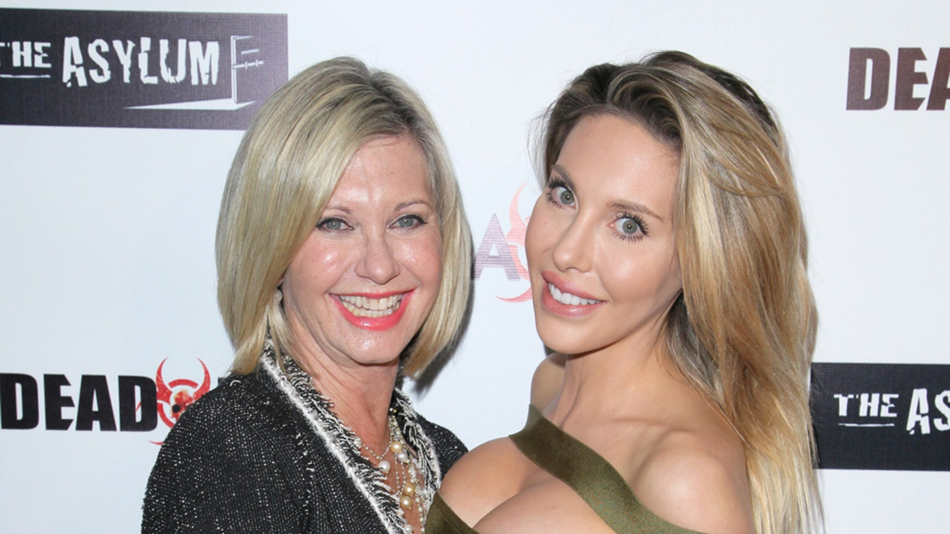 Singer Olivia Newton-John and her daughter Chloe Lattanzi on the red carpet for the Premiere of Syfy's 'Dead 7' at Harmony Gold on April 1, 2016 in Los Angeles.