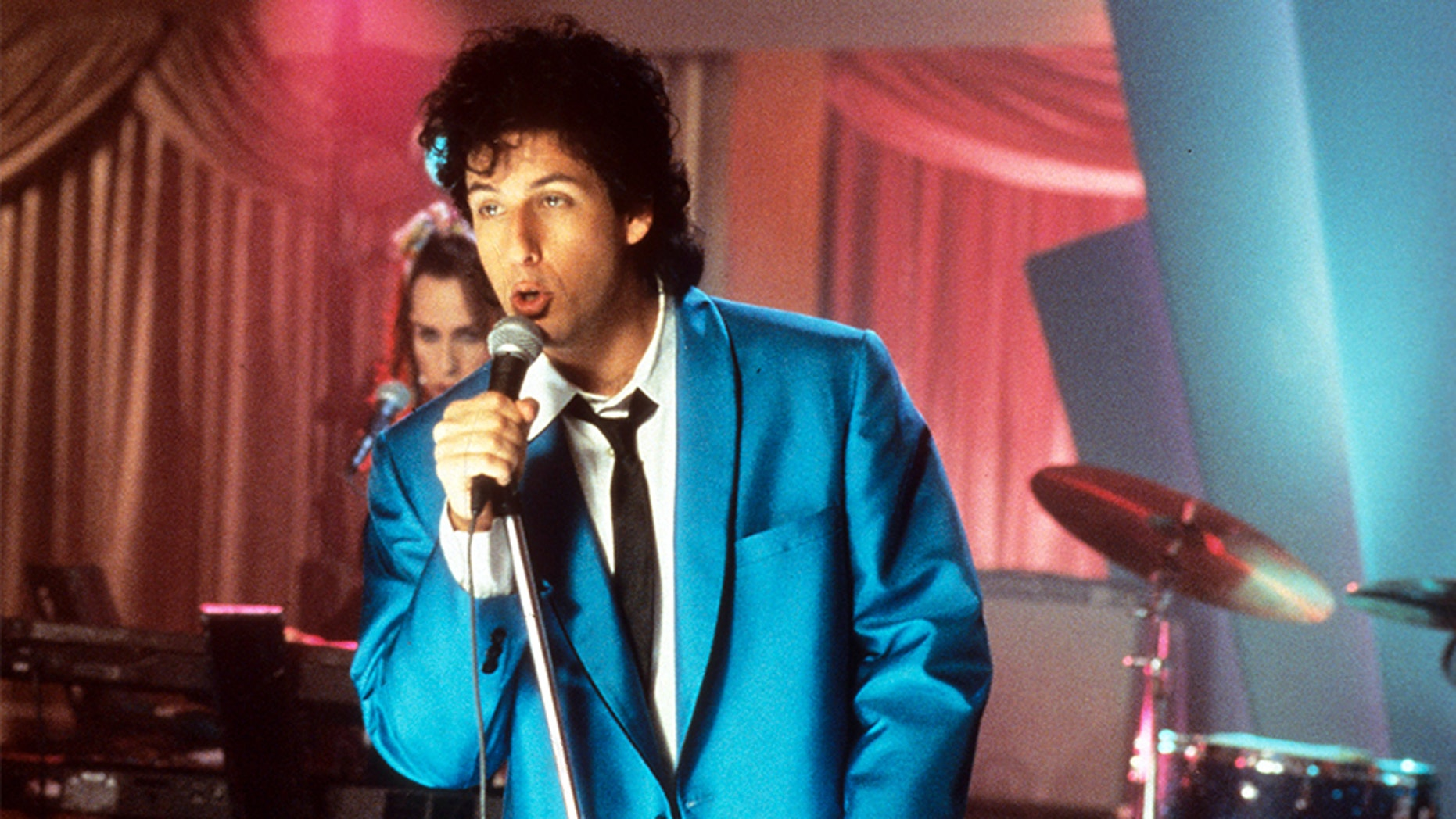 "Adam Sandler sings in a scene from ""The Wedding Singer,"" 1998."