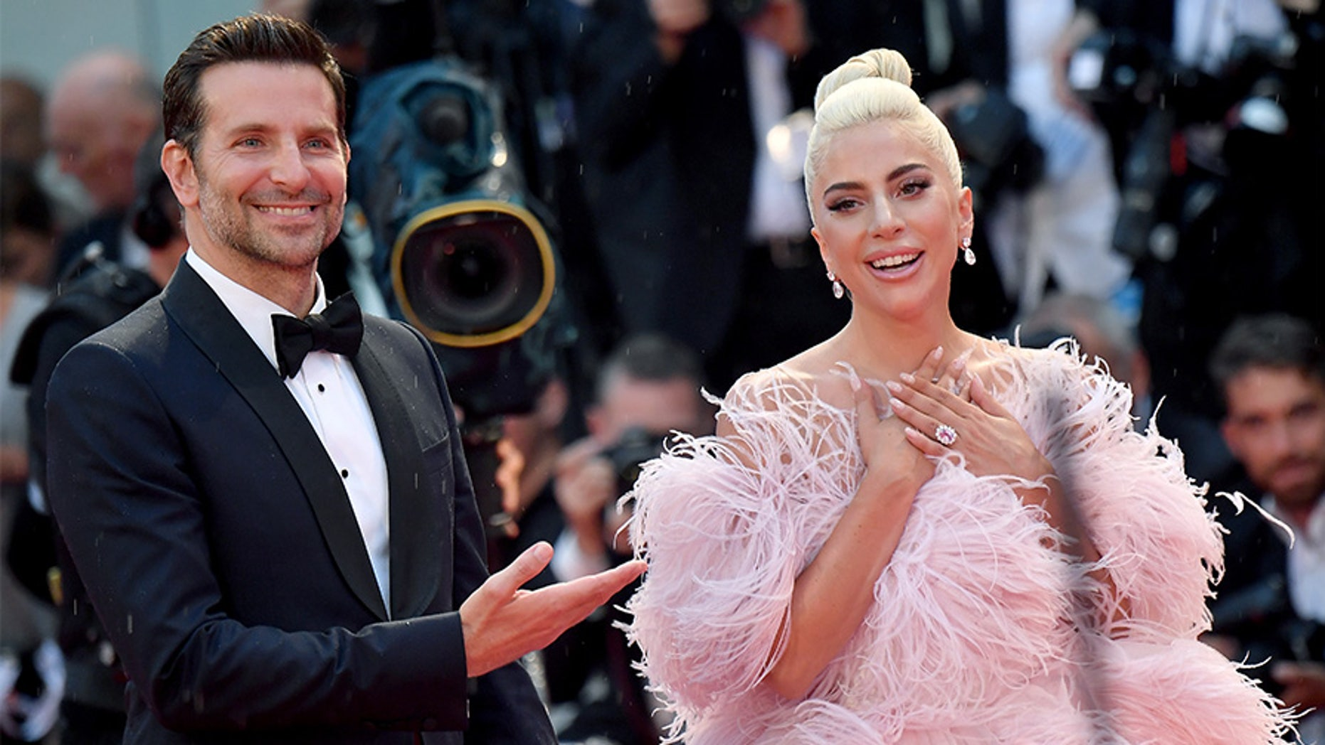 "Bradley Cooper and Lady Gaga take turns sharing the spotlight at the 'A Star Is Born""' premiere during the Venice Film Festival."