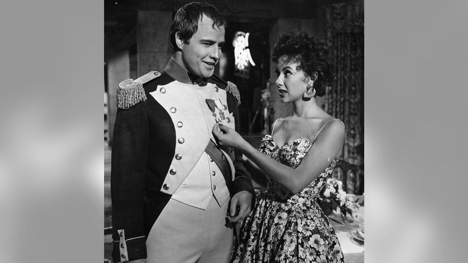 "Marlon Brando and Rita Moreno visit on the set of the film ""Desiree"" in 1954."