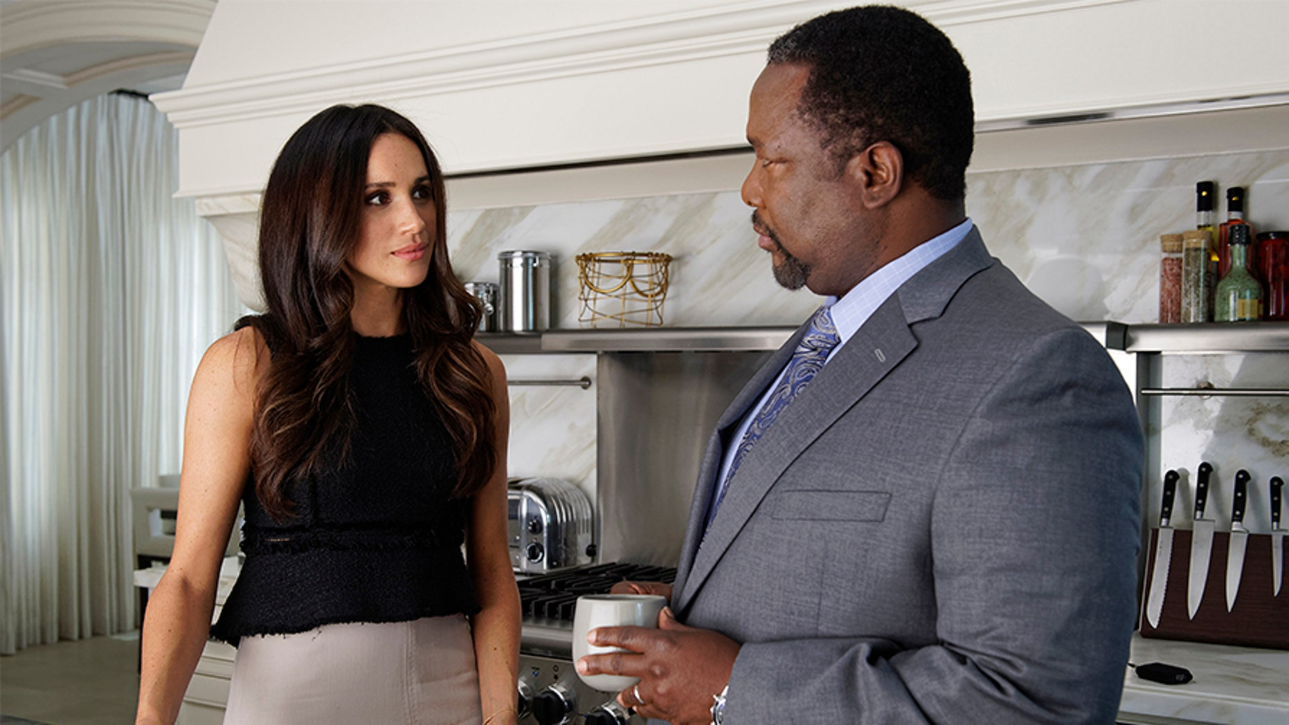 """Meghan Markle and Wendell Pierce filming a scene on """"Suits."""""""