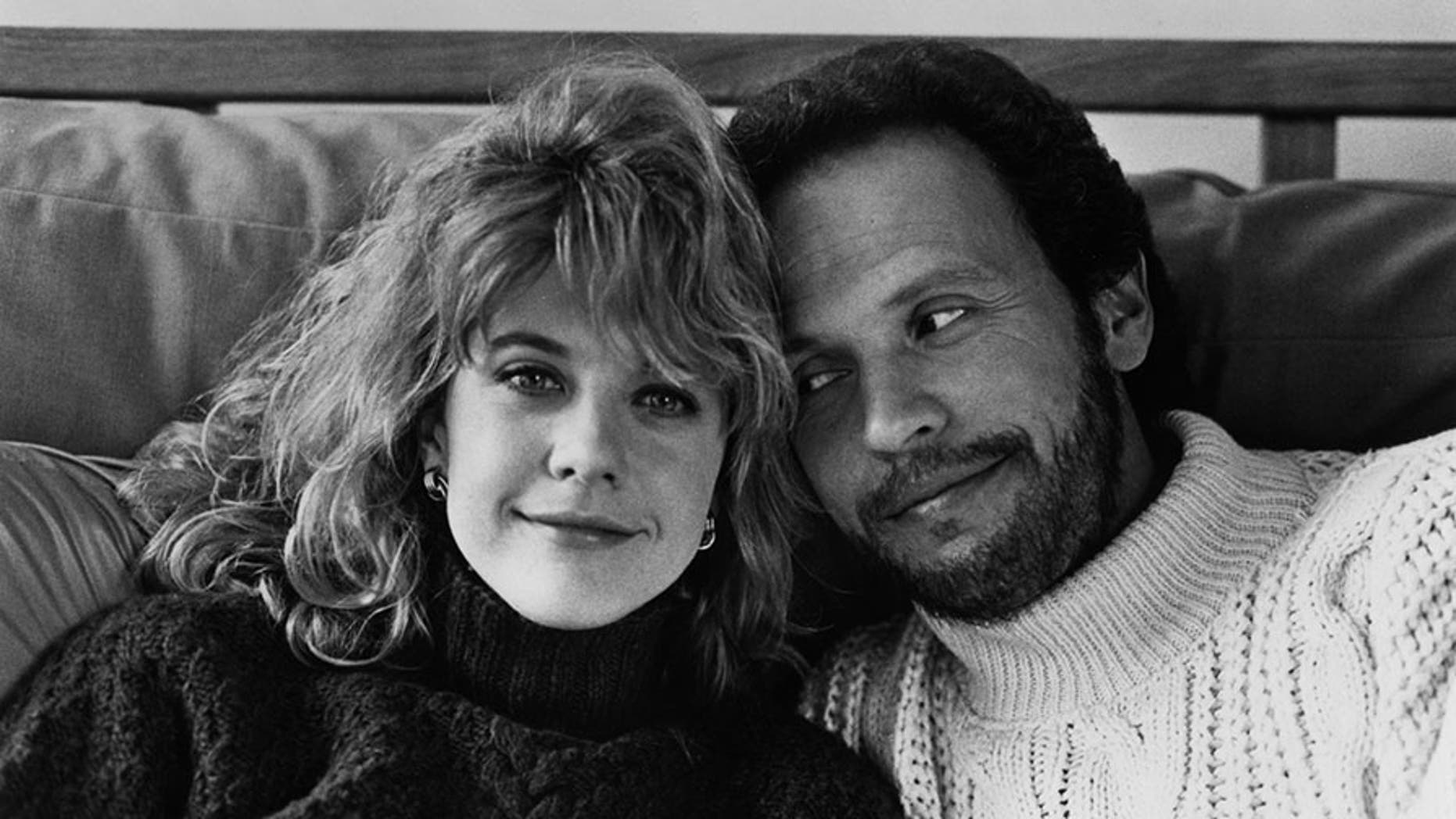 "Meg Ryan and Billy Crystal posing for the movie ""When Harry Met Sally..."" circa 1989."