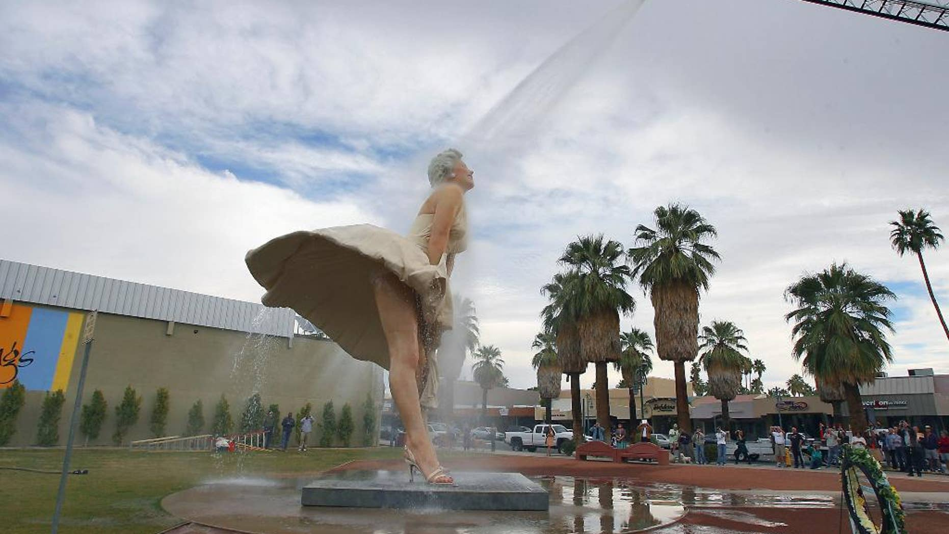 "FILE - This Jan. 23, 2013 file photo shows the ""Forever Marilyn"" sculpture getting a shower from the Palm Springs Fire Department in Palm Springs, Calif. Palm Springs is singing ""Goodbye, Norma Jean."" The city is throwing a send-off party Thursday March 27, 2014, for this massive statue of Marilyn Monroe that has become beloved by both tourists and locals in the two years it was on loan from The Sculpture Foundation.(AP Photo/The Desert Sun, Jay Calderon,File)   RIVERSIDE PRESS-ENTERPRISE OUT;  NO SALES; NO FOREIGN"