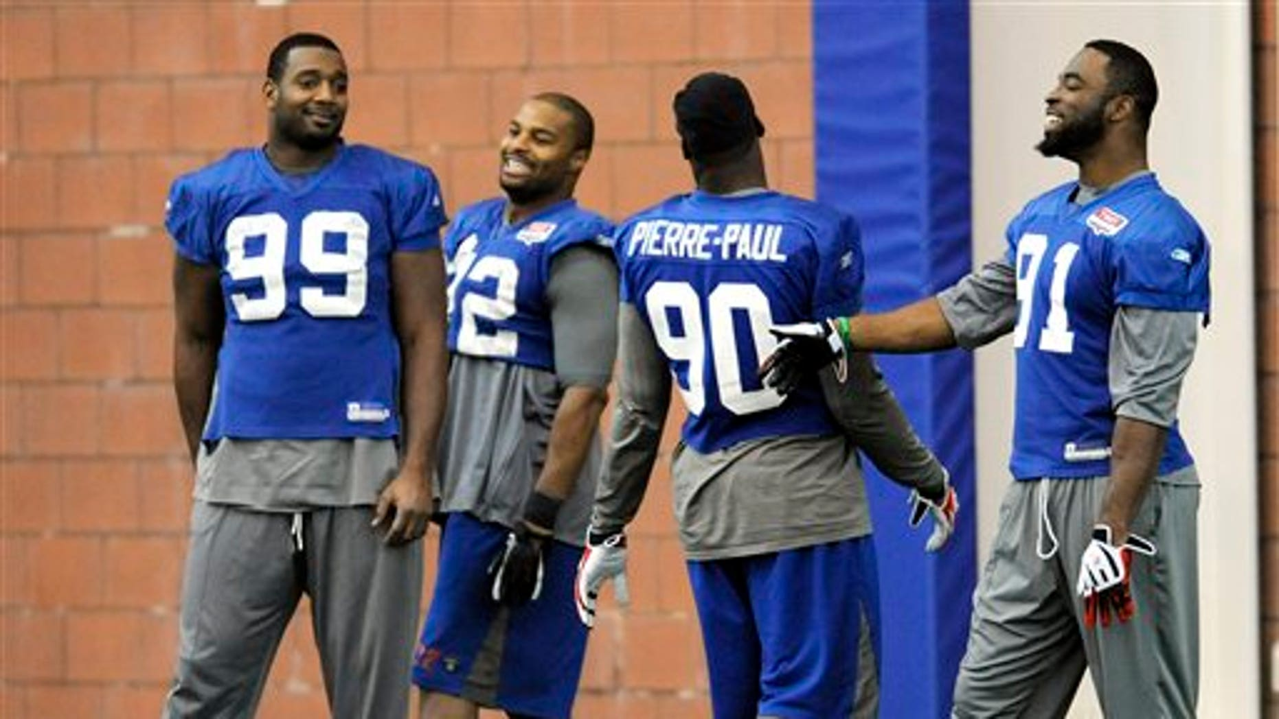 Jan. 19: New York Giants -- Chris Canty (99), Osi Umenyiora (72), Jason Pierre-Paul (90) and Justin Tuck  share a laugh during NFL football practice in East Rutherford, New Jersey.