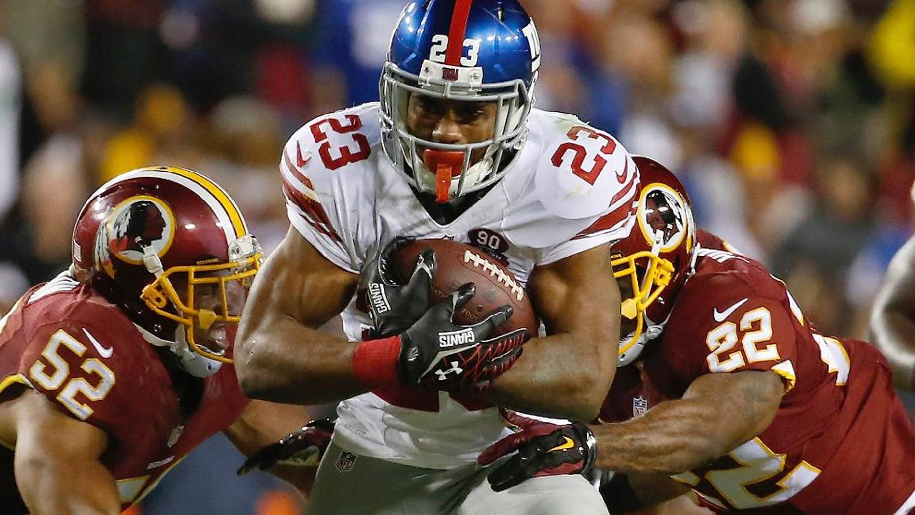FILE - In this Se[t. 25, 2014, file photo, New York Giants running back Rashad Jennings (23) carries the ball during the second half of an NFL Thursday night football game against the Washington Redskins in Landover, Md.  The dormant Giants running game seemingly is going to get its top halfback back on the field this weekend when Rashad Jennings plays against the San Francisco 49ers. (AP Photo/Alex Brandon, File)