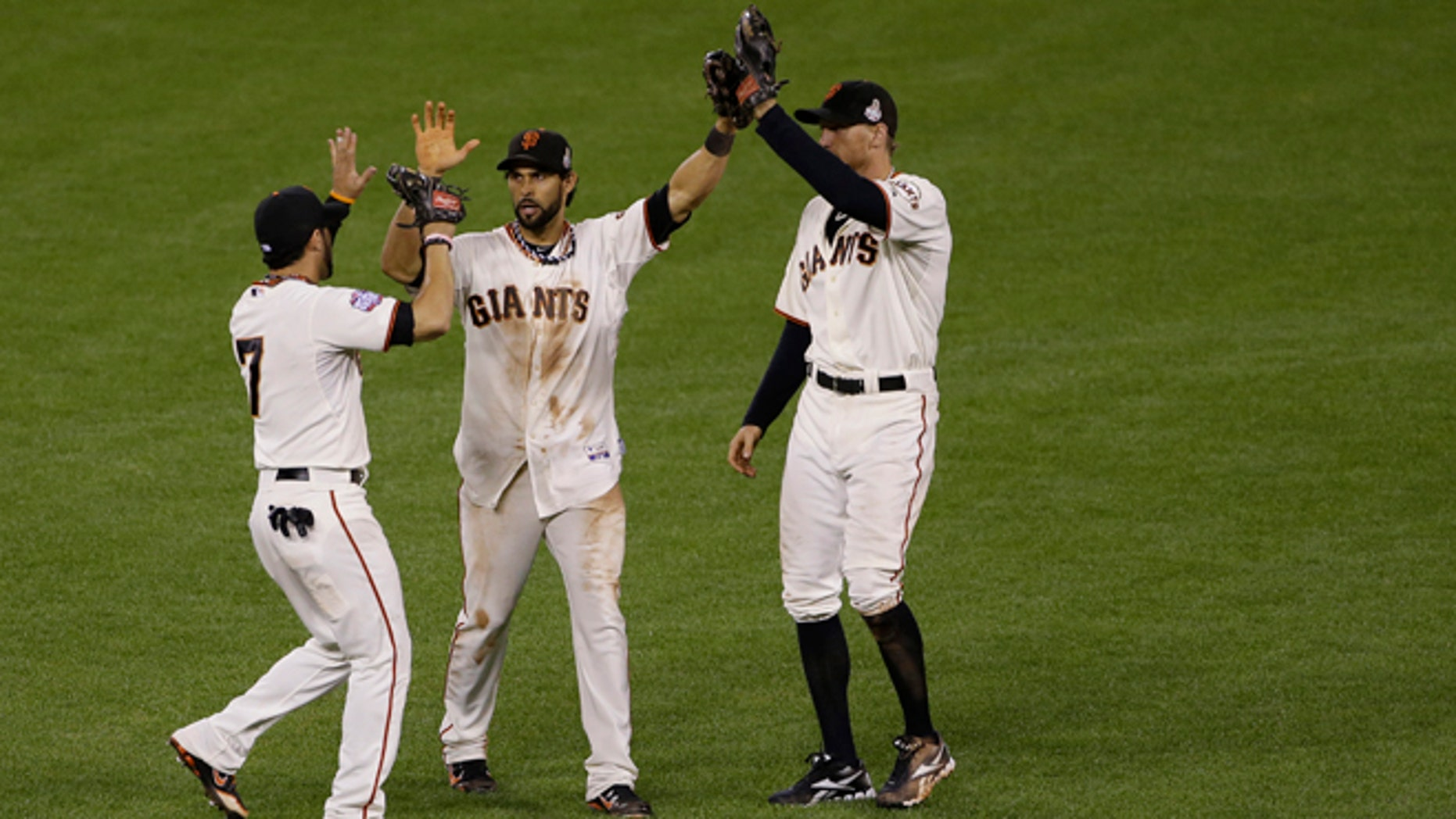 Oct. 25, 2012: San Francisco Giants' Gregor Blanco, left, Angel Pagan, middle, and Hunter Pence celebrates after the Giants defeated the Detroit Tigers, 2-0, in Game 2 of baseball's World Series in San Francisco.