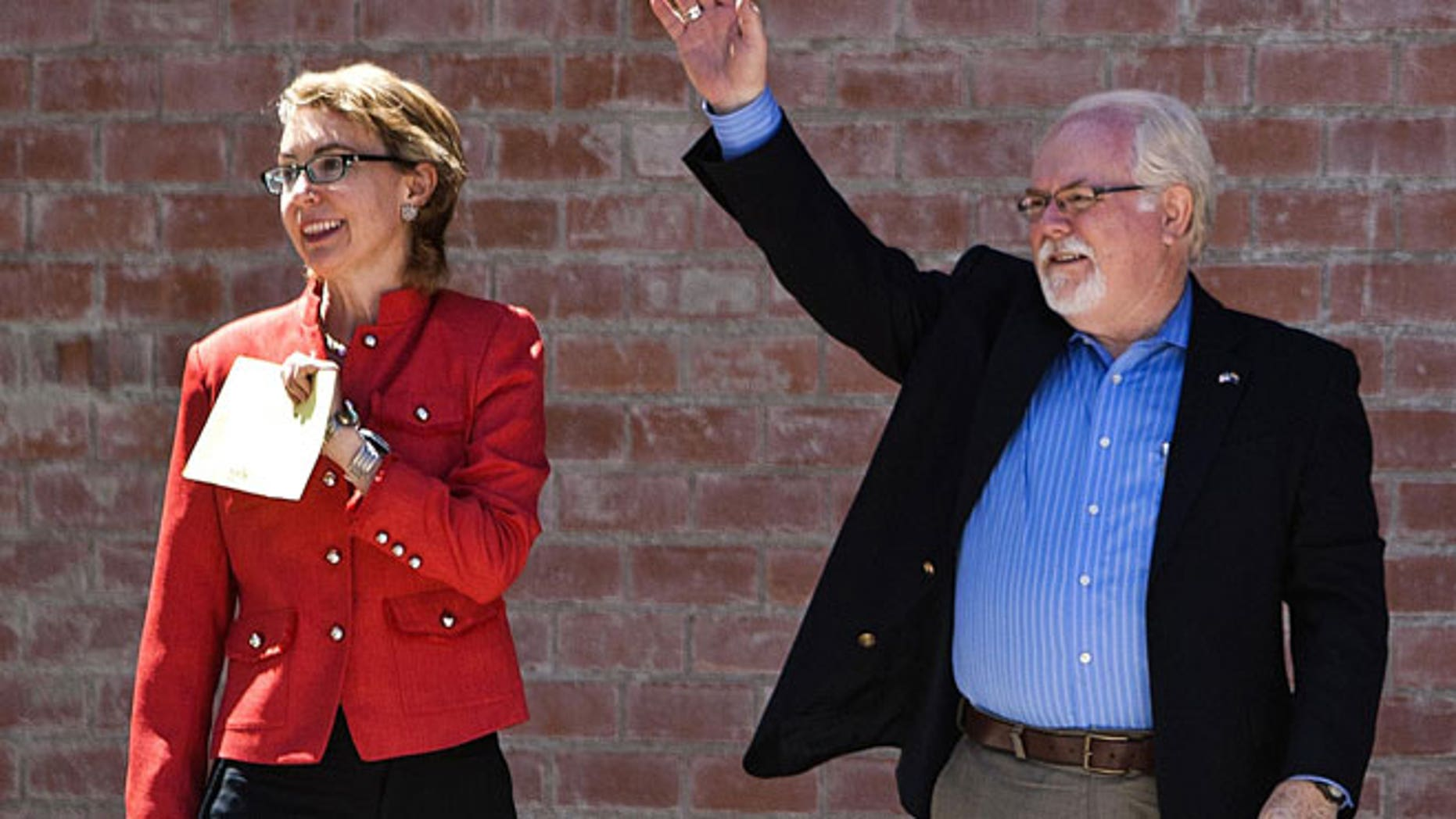 June 12, 2012: Former Rep. Gabrielle Giffords, left, and Ron Barber enter the polling place at St. Cyril's Catholic Church in Tucson, Ariz.