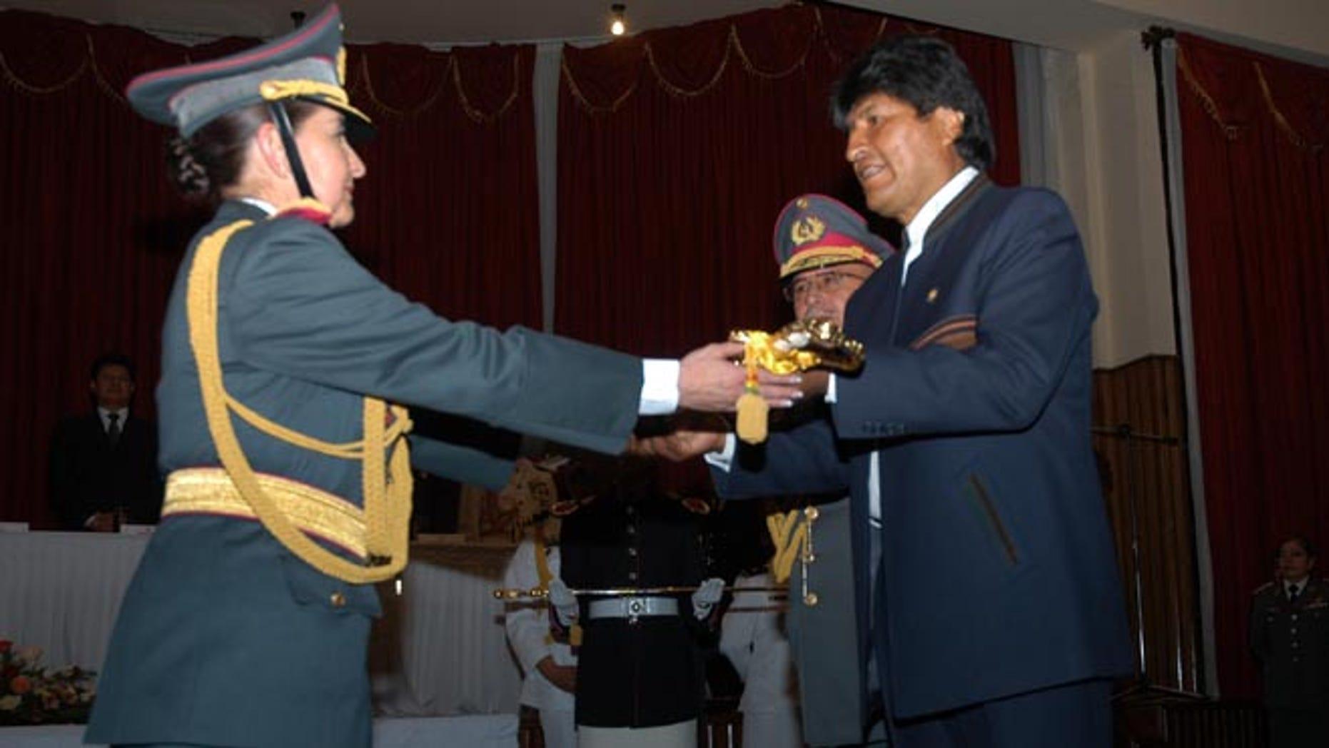 Bolivian Gen. Gina Reque Terán (L) with Bolivian President Evo Morales (R).