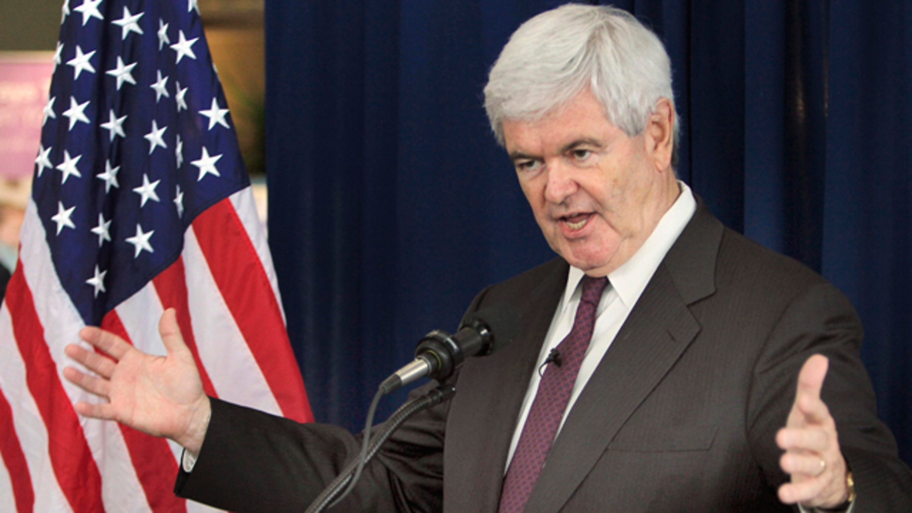 FILE - Republican presidential hopeful, former House Speaker Newt Gingrich gestures while speaking during a Town Hall style meeting at the Derry Medical Center  in Derry, N.H., in this May 25, 2011 file photo. The entire top echelon of Newt Gingrich's presidential campaign resigned on Thursday, June 9, 2011 a stunning mass exodus that left his bid for the Republican nomination in tatters. But the former House speaker vowed defiantly to remain a candidate.