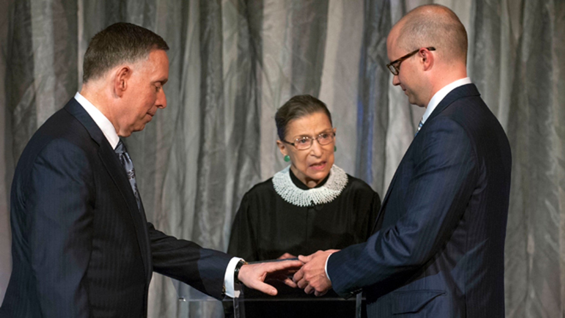Aug. 31, 2013: This photo provided by The Kennedy Center shows Michael M. Kaiser, left, and John Roberts,  right, being married by Justice Ruth Bader Ginsburg, center,  at the Kennedy Center.